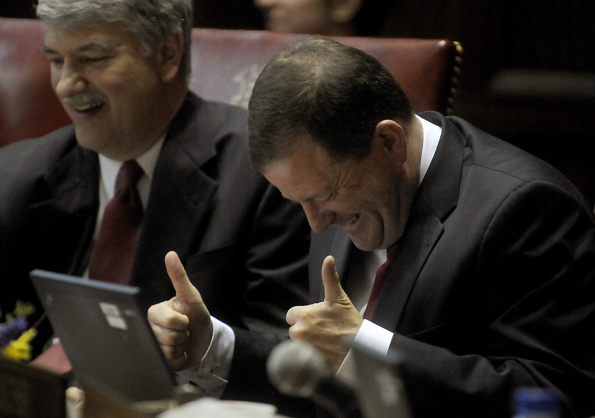 Senate Minority Leader John McKinney gives the thumbs-up as one of many senators saluted him and Senate President Pro Tem Donald E. Williams, left, during farewell speeches Wednesday night at the end of the legislative session. Both men are leaving the Senate.