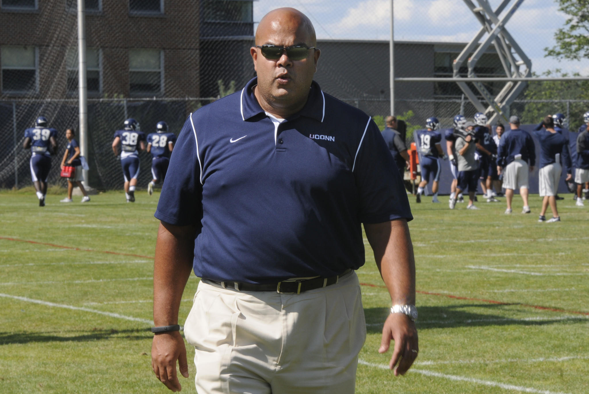UConn athletic director Warde Manuel played football at the University of Michigan and says he never thought of himself as a school employee when he played.
