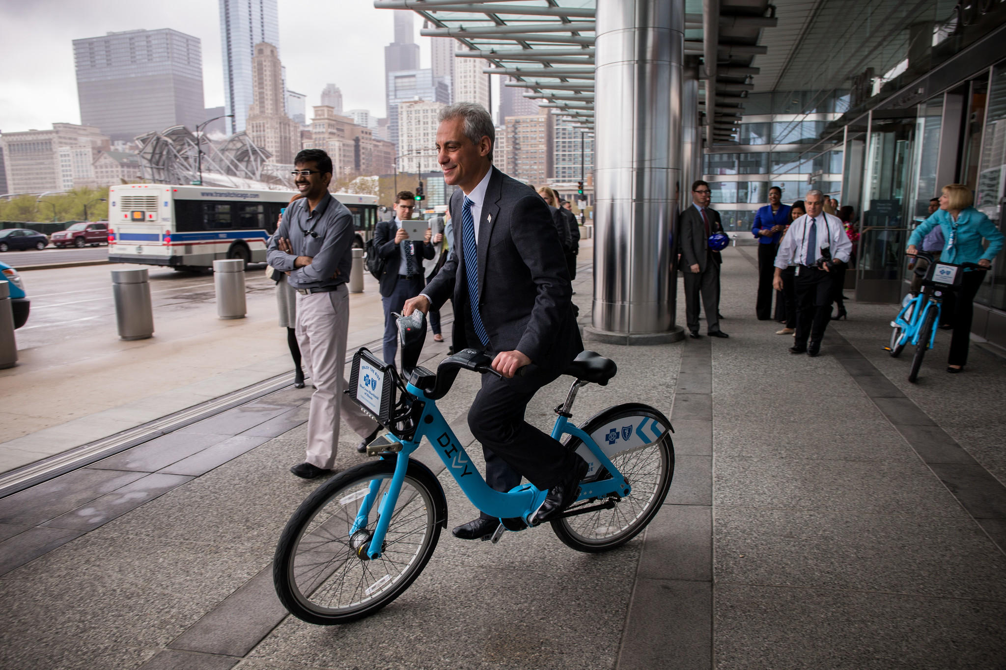 Mayor Rahm Emanuel rides Divvy bike in front of the Blue Cross Blue Shield of Illinois building after announcing a new partnership to support Divvy bike share and bicycling programs in Chicago on May 1.