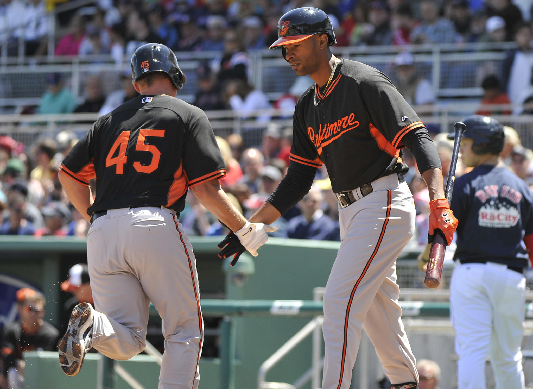 Henry Urrutia (right) greets Orioles catcher Steve Clevenger (left) after hitting a solo home run against the Boston Red Sox at JetBlue Park in Spring Training.