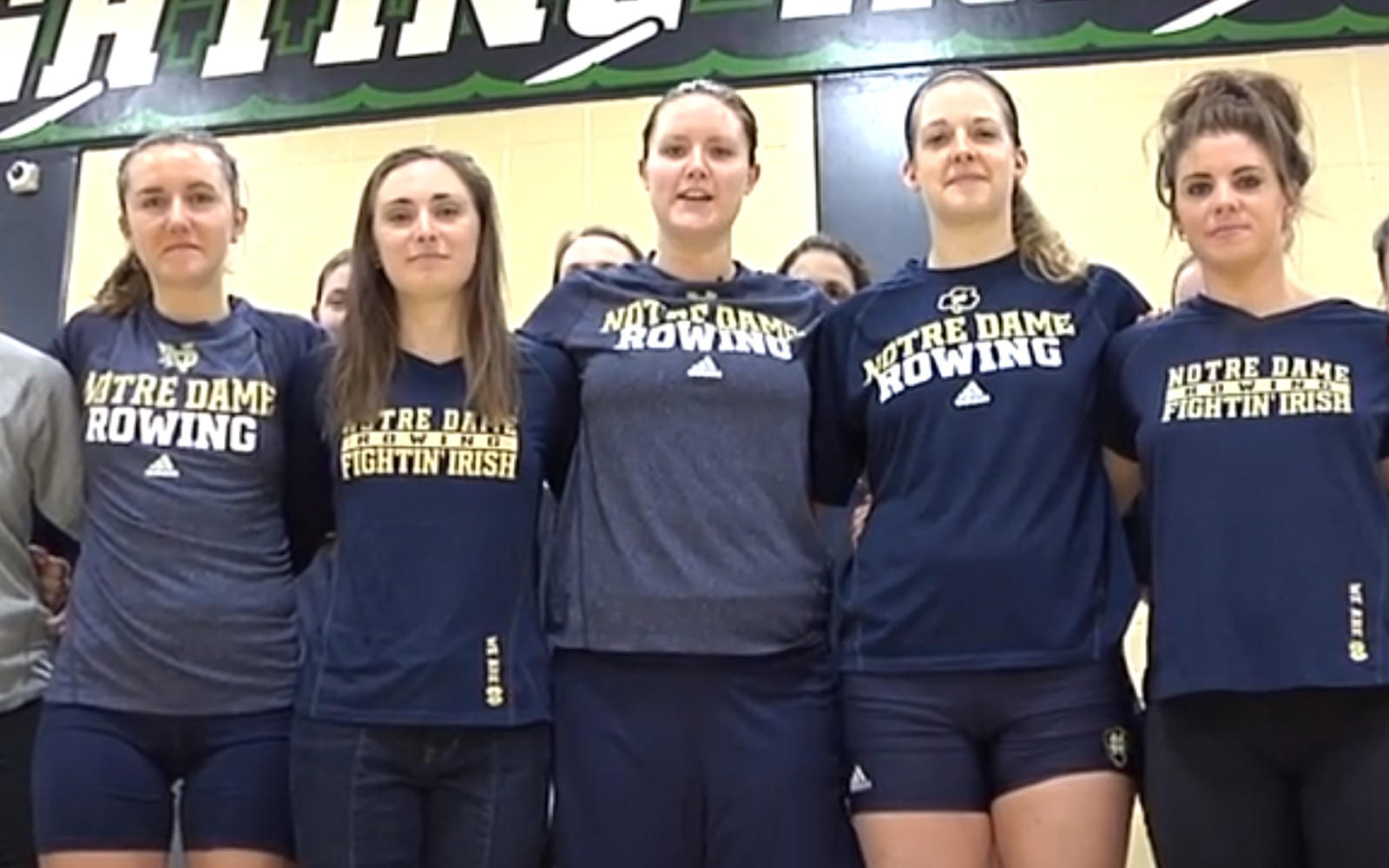 "Notre Dame rower Olivia Kacsits, center, identifies herself as an out student athlete in Notre Dame promotional video titled ""At Notre Dame, If You Can Play, You Can Play"" on YouTube."