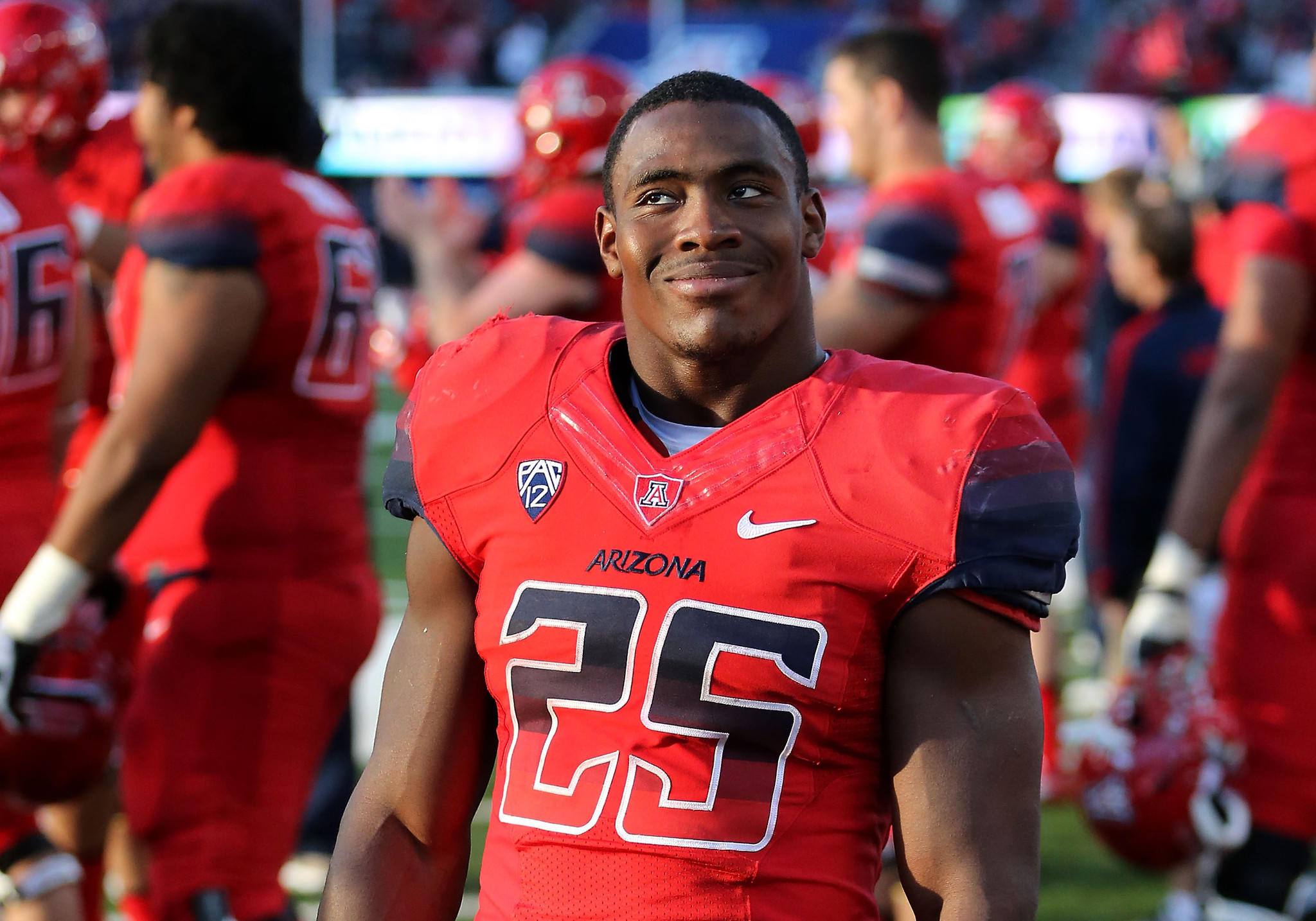 Running back Ka'Deem Carey of the Arizona Wildcats in 2013.