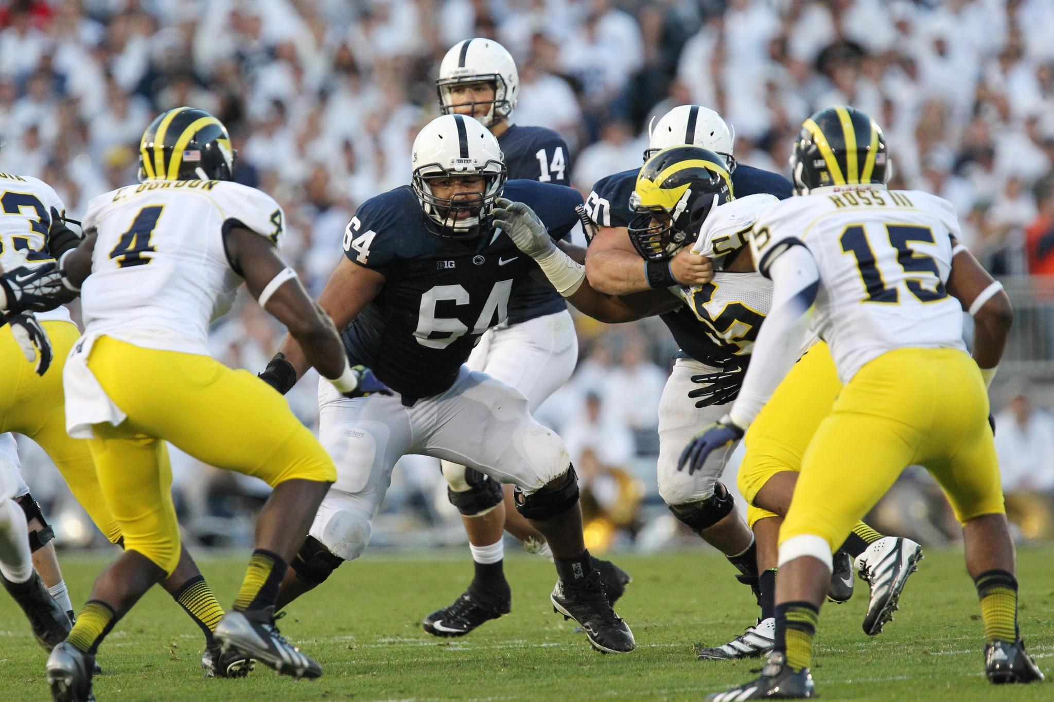 Penn State guard John Urschel attempts to block during the second quarter against Michigan in October. The Ravens drafted Urschel in the fifth round.