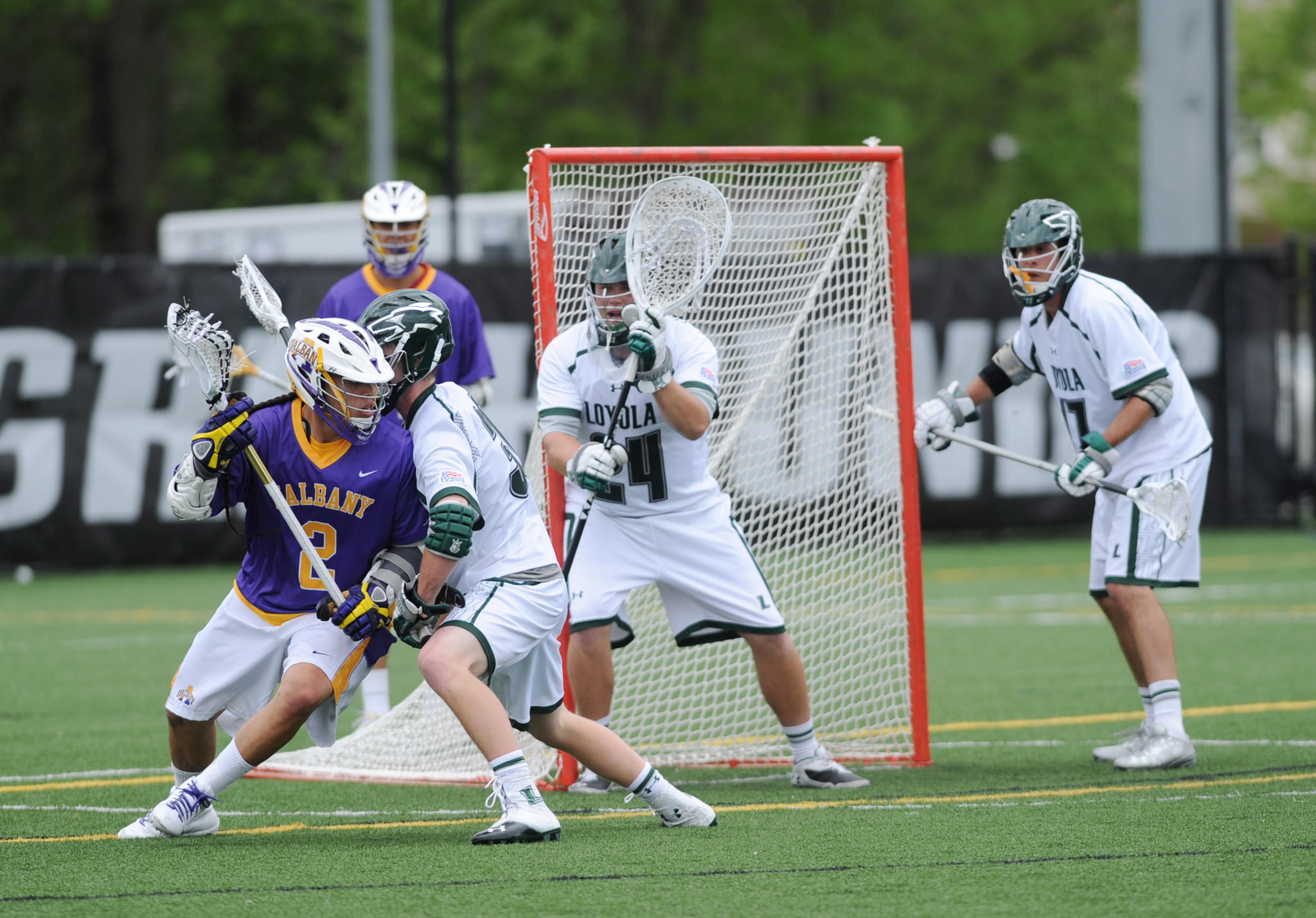 Albany's Miles Thompson (2) is checked by Loyola's Pat Frazier.