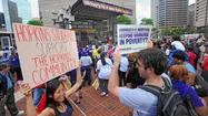 Thousands gather to protest pay at Hopkins Hospital