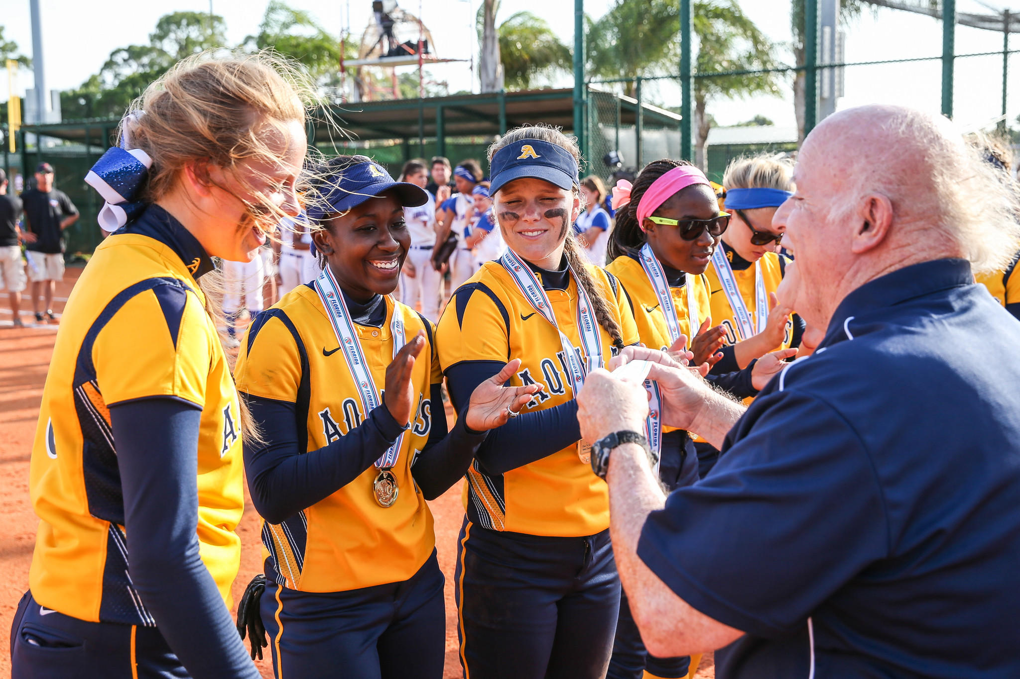 J. PATRICK RICE / SPECIAL TO THE SENTINEL St. Thomas Aquinas Raiders pitcher Meghan King (L) receives her medal with her teammates after winning the 2014 FHSAA Class 7A Championship game against Harmony played at Historic Dodgertown in Vero Beach on Saturday, May 10, 2014. ORG XMIT: B583717577Z.1
