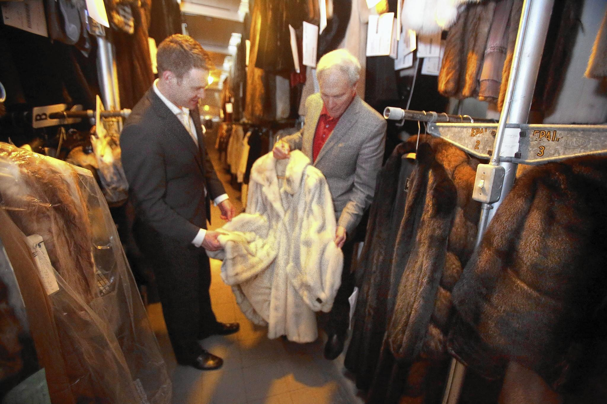 Son Alex LaBellman and father Art LaBellman look at furs in their cold storage facility at their downtown store. LaBelle Furs has been a family business for 95 years in downtown Orlando.