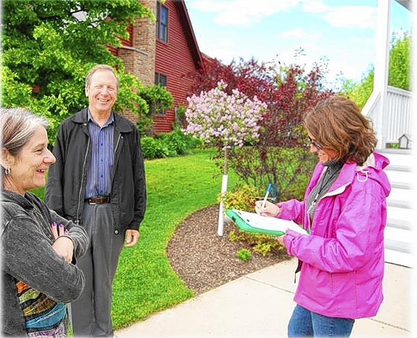 Mary Fortmann, sustainable landscapes coordinator for Conserve Lake County, visits the property of Bill and Cindy Dietz of Grayslake. Their property qualified for Conservation @ Home certification.