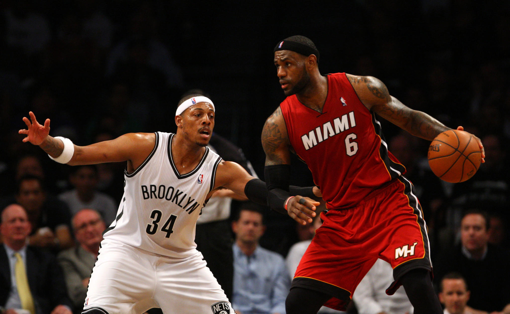 Nets forward Paul Pierce defends Heat forward LeBron James in the second half of Game 4 Monday at the Barclays Center.