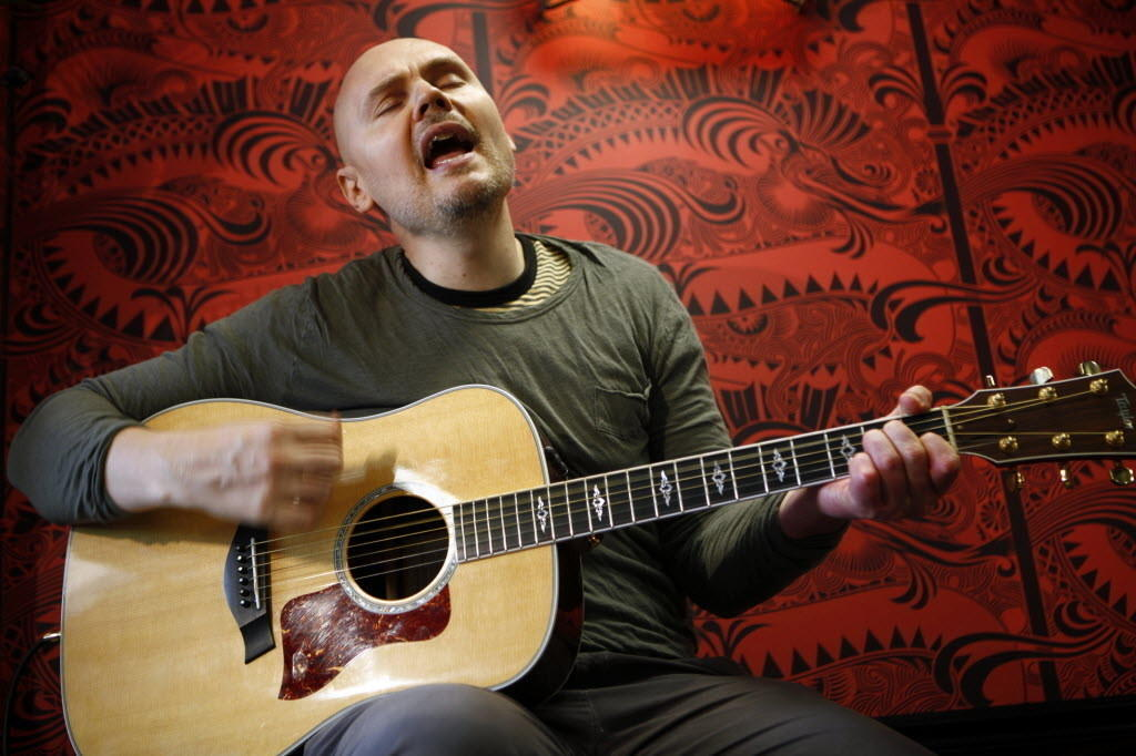 Billy Corgan, of Smashing Pumpkins, sings for gathered customers, fans and Highland Park residents in September 2012 on the opening day of Madame ZuZu's, a Highland Park tea shop he co-owns.