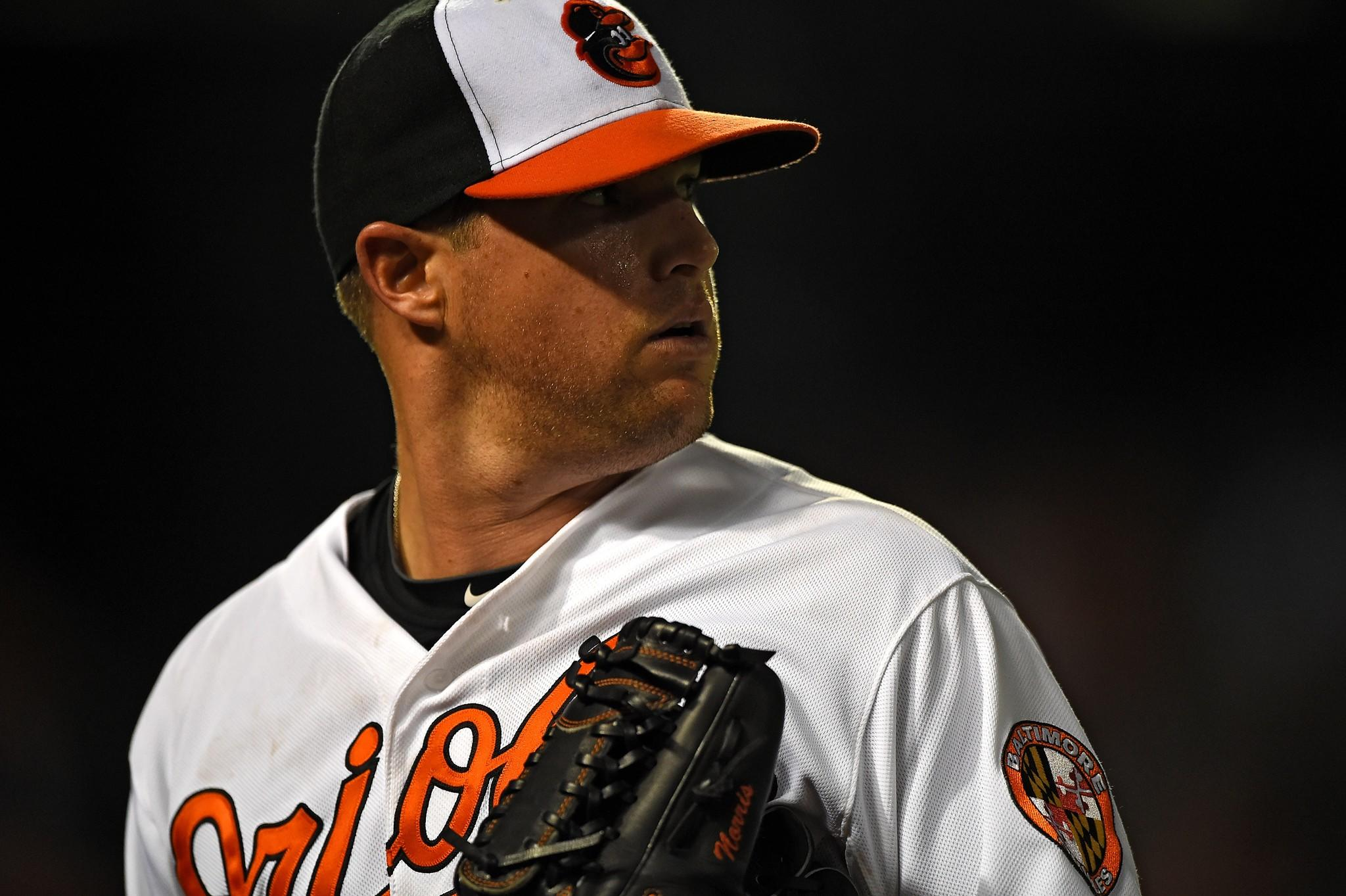 Orioles pitcher Bud Norris walks to the dugout in the eighth inning after hitting Torii Hunter.