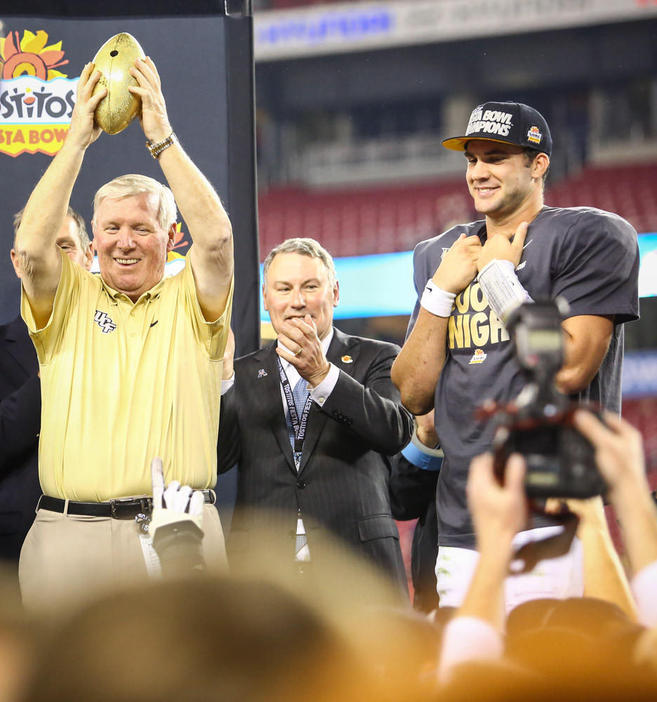 UCF coach George O'Leary, and quarterback Blake Bortles (5) celebrate on the awards platform after their 52-42 victory over Baylor in the Tostitos Fiesta Bowl at the University of Phoenix stadium in Glendale, AZ. on Wednesday, January 01, 2014. (Joshua C. CrueyOrlando Sentinel)