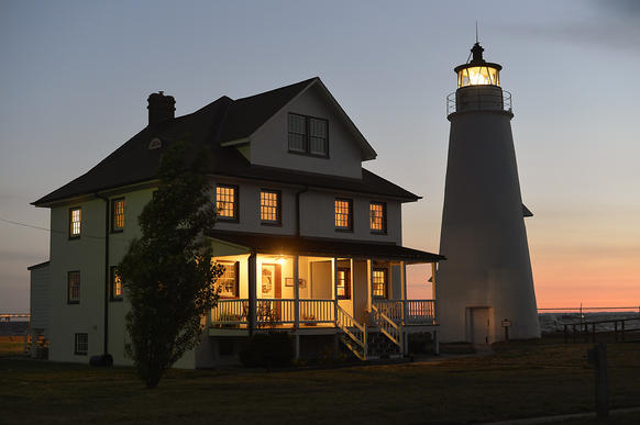 3500 Lighthouse Blvd., Lusby, Calvert County<BR> 410-474-5370 or calvertmarinemuseum.com<BR> $550-$1,600 (for minimum three-day stay) <BR><BR> 80 miles from Baltimore <BR><BR> The days of the grizzled lighthouse keeper may be long gone -- just about all lighthouses operate on their own these days -- but that doesn't mean you can't live like one, at least for a few days. <BR><BR> Isolated on a spit of Calvert County land jutting into the Chesapeake Bay, the 186-year-old Cove Point Light is as much a welcome light as a warning beacon these days. And for real lighthouse fanatics, spending a few nights in the adjacent keeper's cottage is a time-traveling opportunity not to be missed.