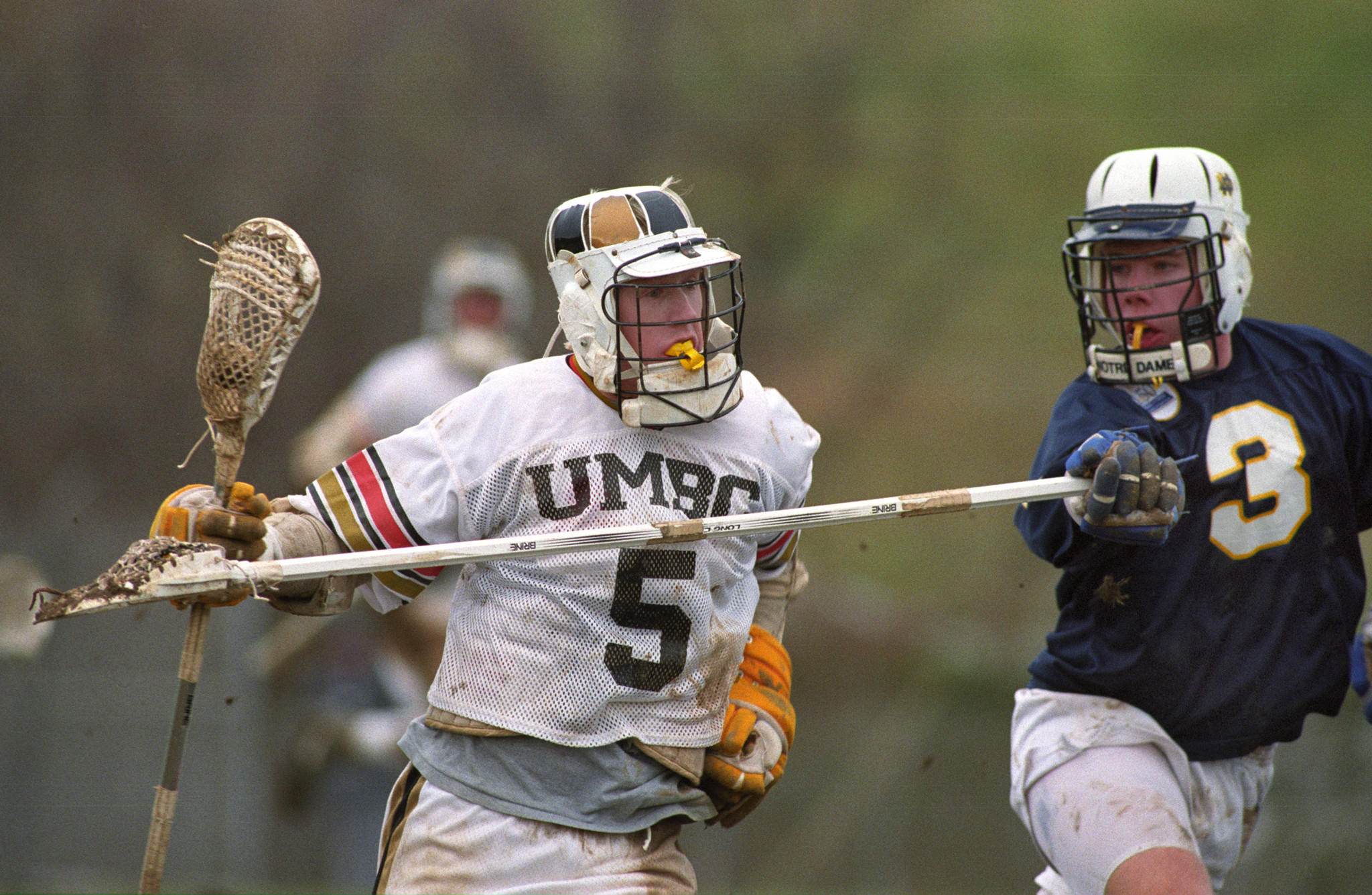 UMBC's Steve Marohl (5) carries the ball as Notre Dame's Garrett Reilly defends in a 1992 game. The Retrievers won, 13-7.