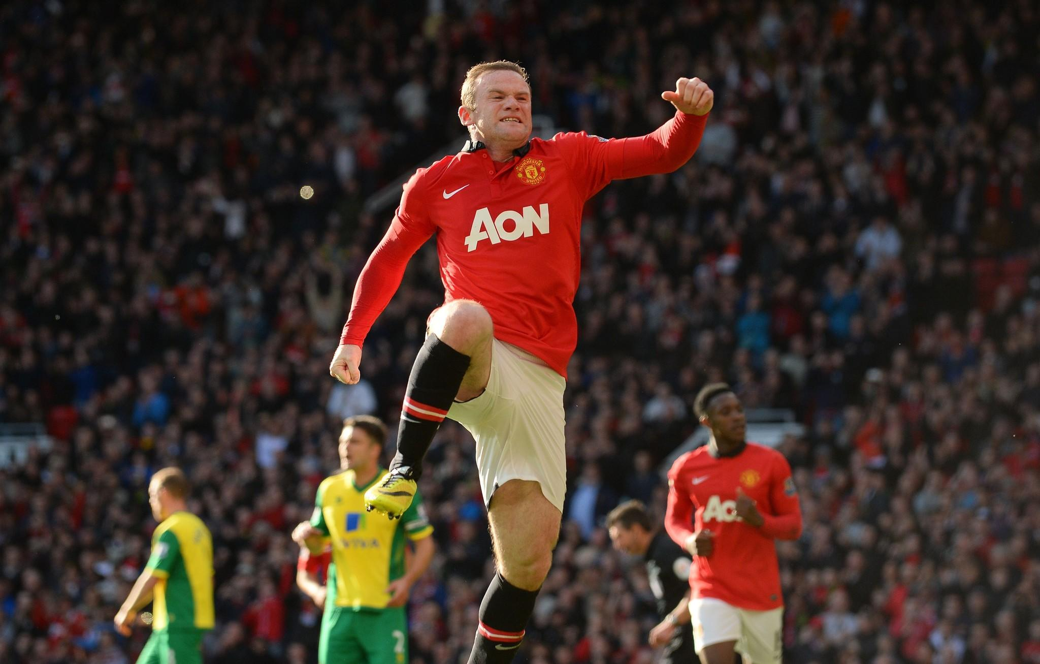 Manchester United's English striker Wayne Rooney celebrates after scoring a penalty during the English Premier League football match between Manchester United and Norwich City at Old Trafford in Manchester, northwest England, on April 26, 2014.