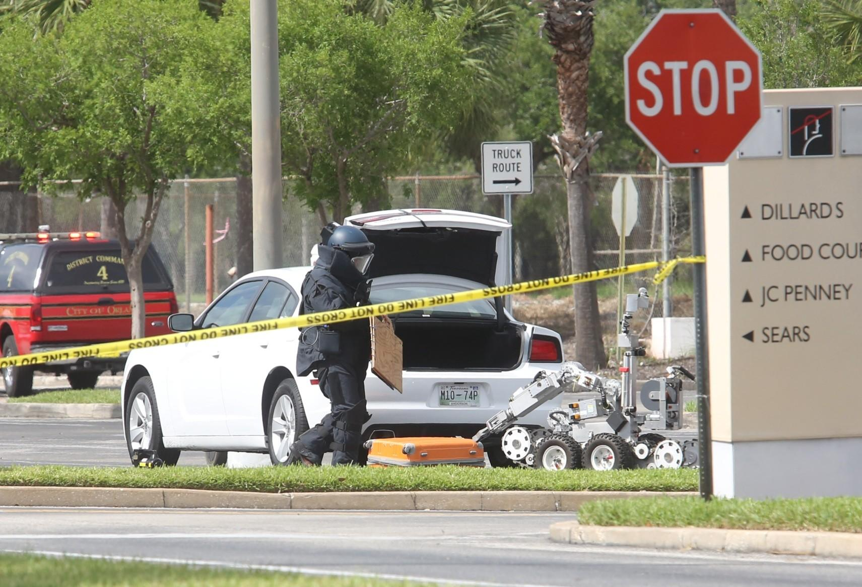 The Orlando Police Department bomb squad checks a suspicious car parked outside Orlando Fashion Square.