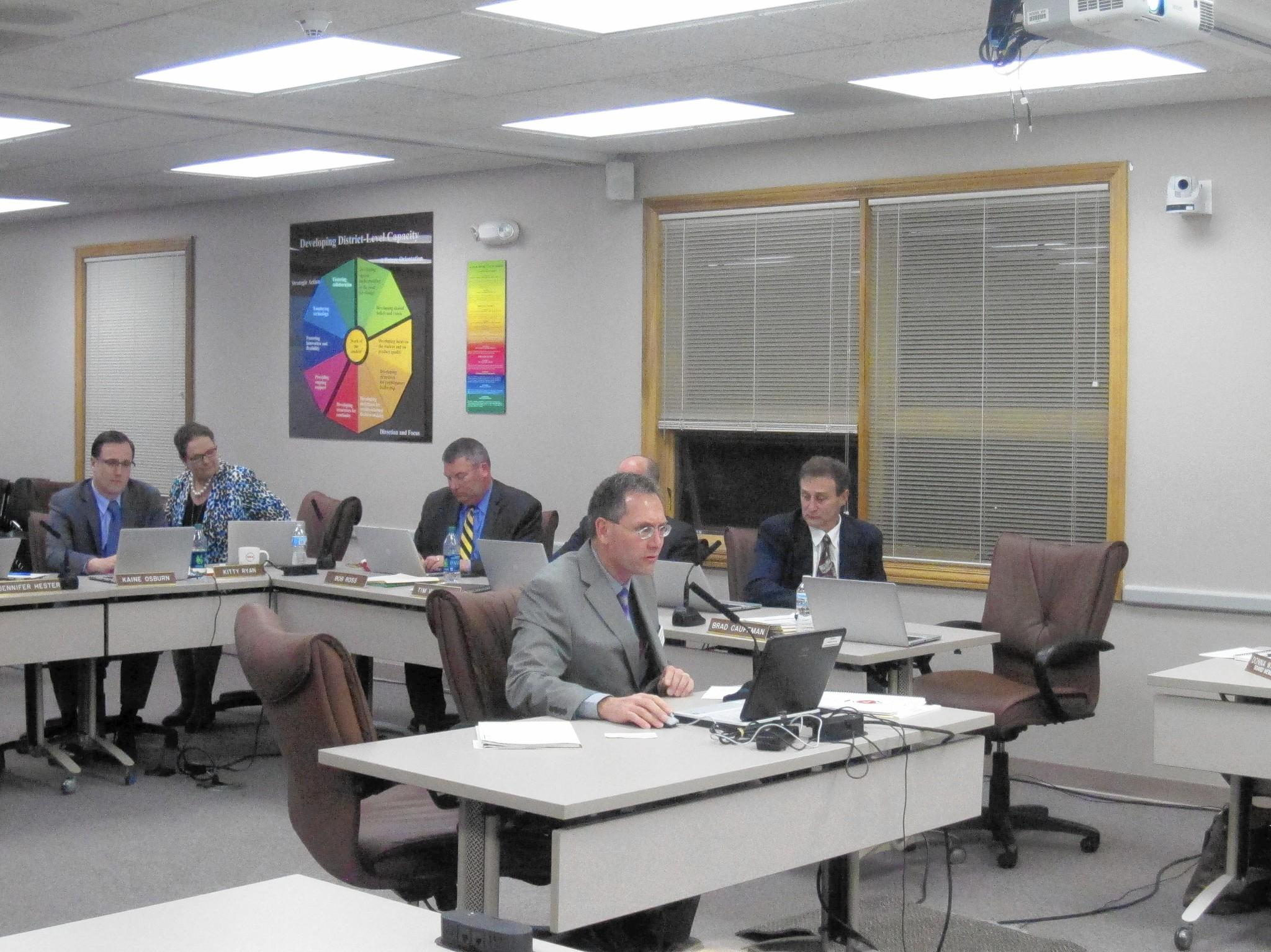 Naperville Unit District 203 Chief Financial Officer Brad Cauffman presents the budget to the school board.