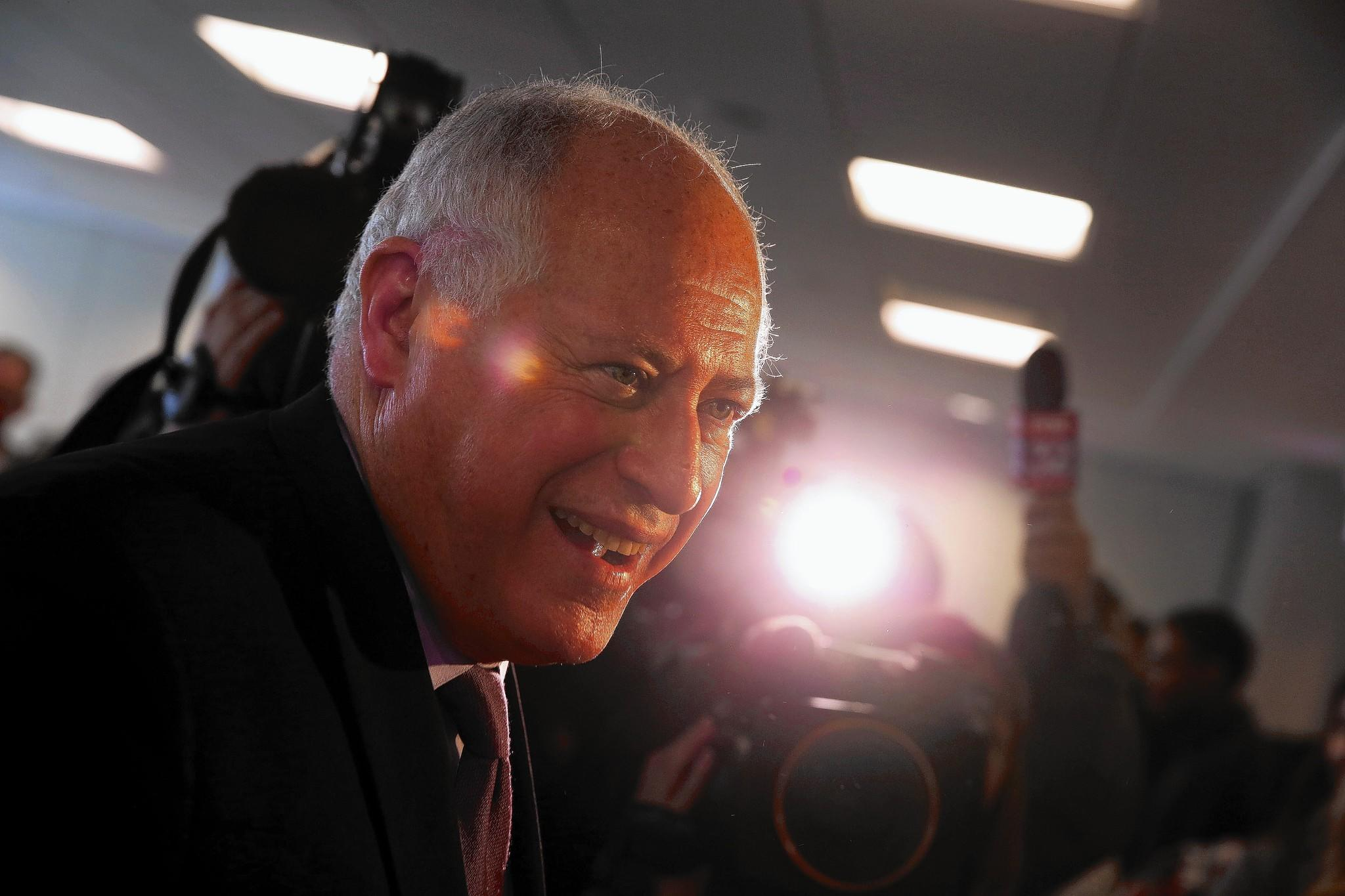Illinois Governor Pat Quinn shakes hands as he prepares to exit after getting the endorsement of the Service Employment International Union (SEIU).