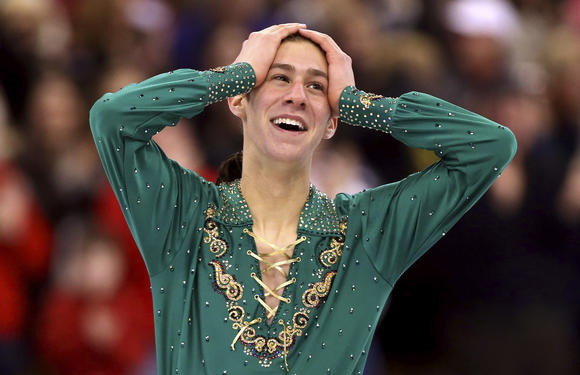 Jason Brown reacts with delighted shock to the standing ovation for his free skate at the 2014 U.S. Championships.
