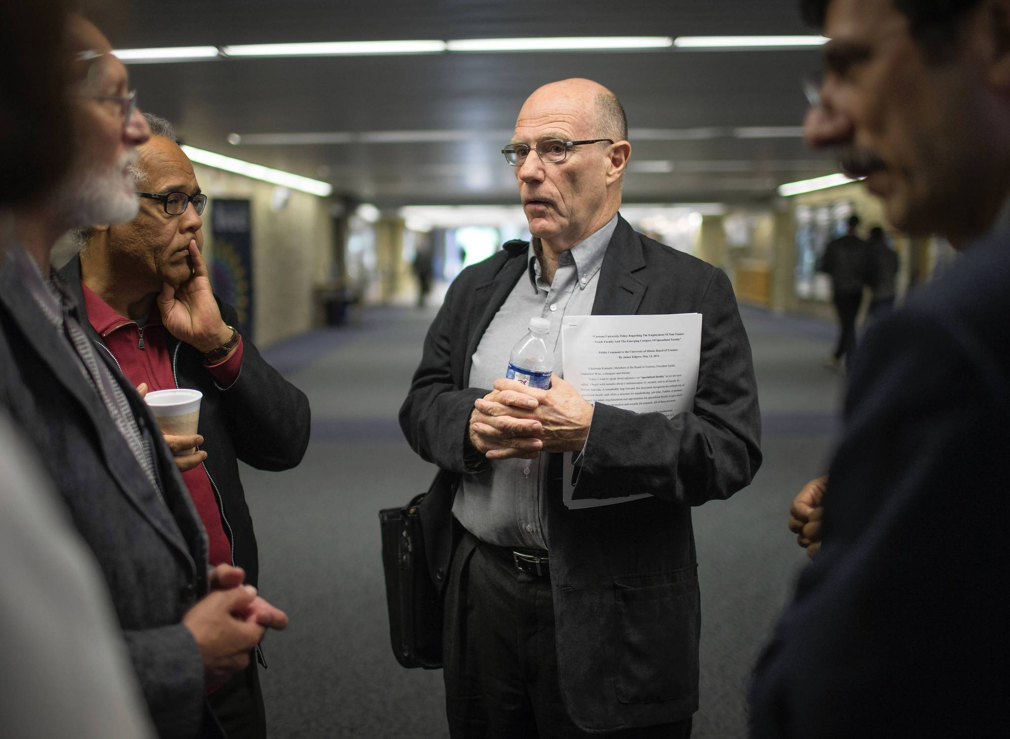 James Kilgore speaks to colleagues after a board meeting at the University of Illinois Springfield campus.