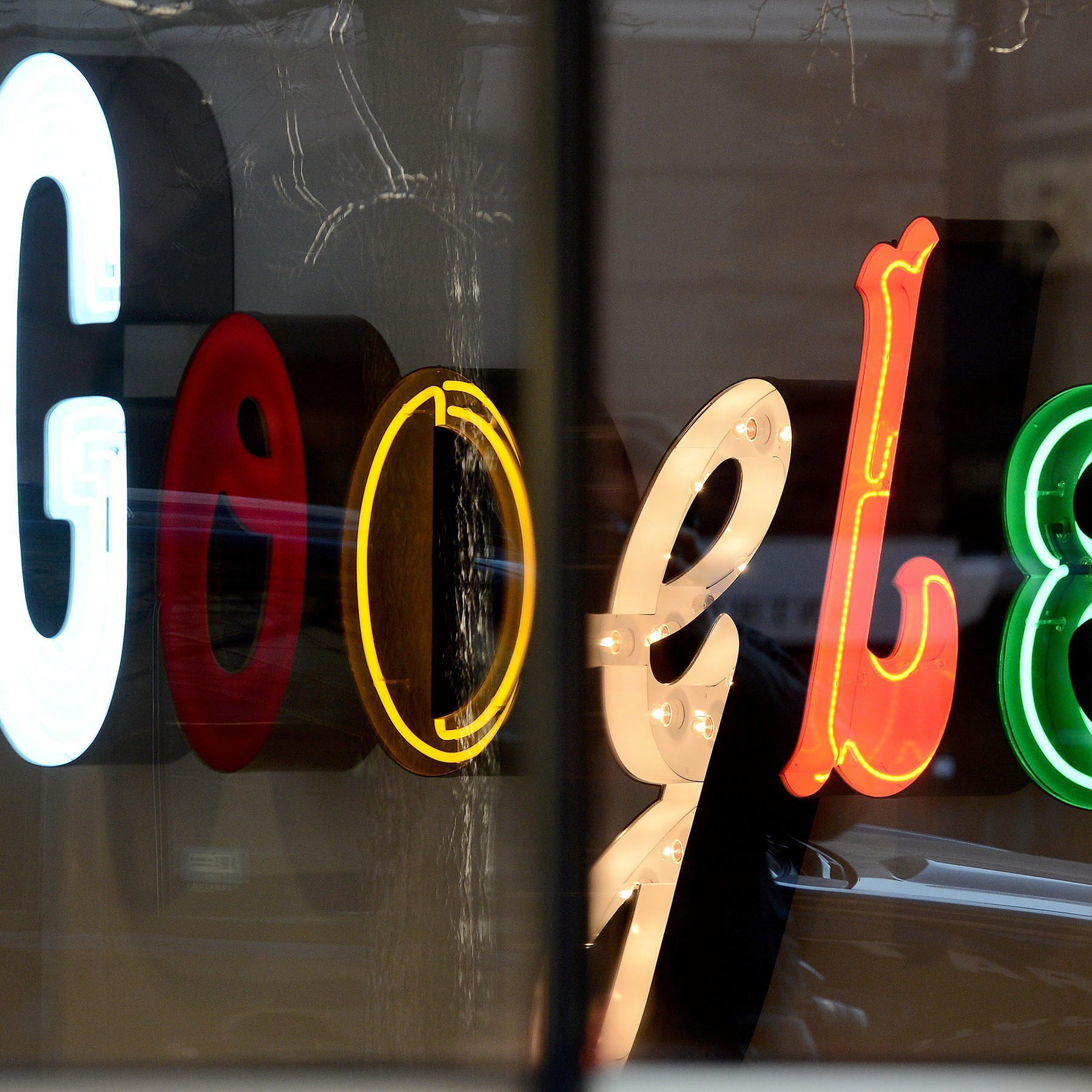 A Google logo is displayed at Google's New York offices.
