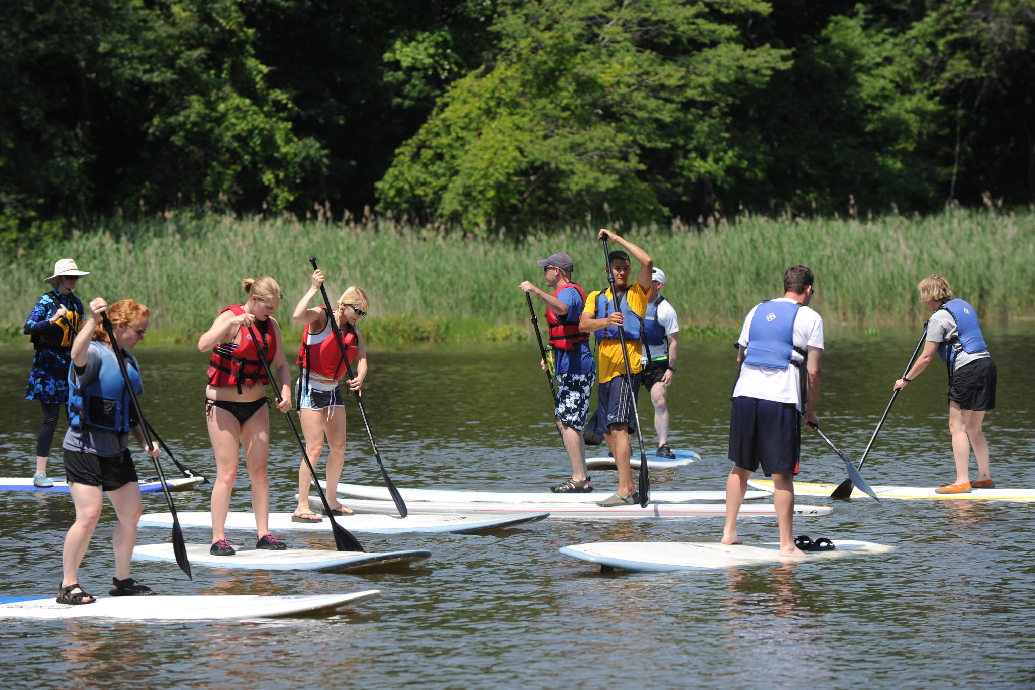 Students begin to test their abilities during a stand-up paddleboard lesson offered by Ultimate Watersports at Gunpowder Falls State Park on June 9, 2012.