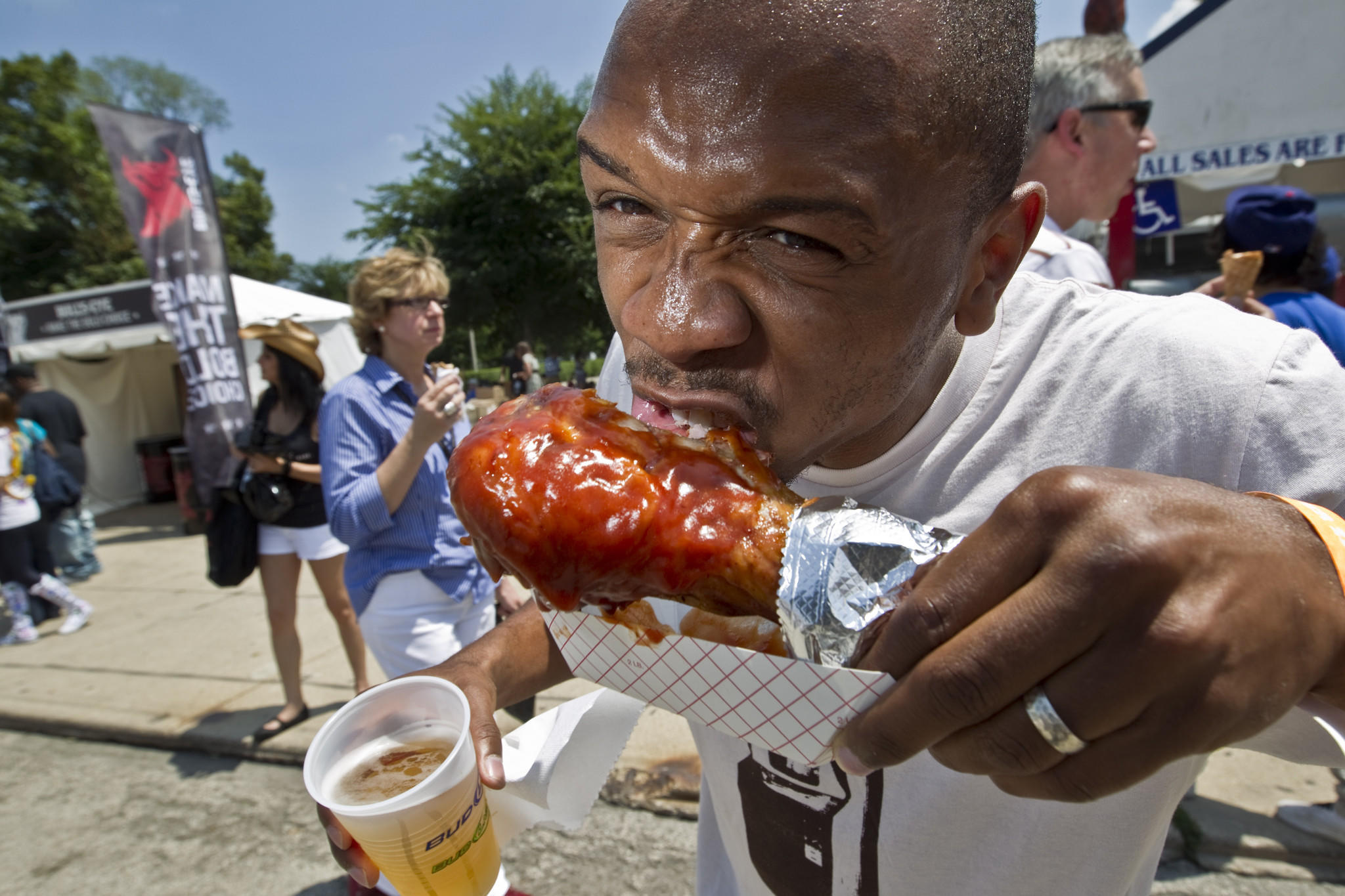 Gregory Edwards, from Chicago, enjoys a turkey leg at Taste of Chicago.