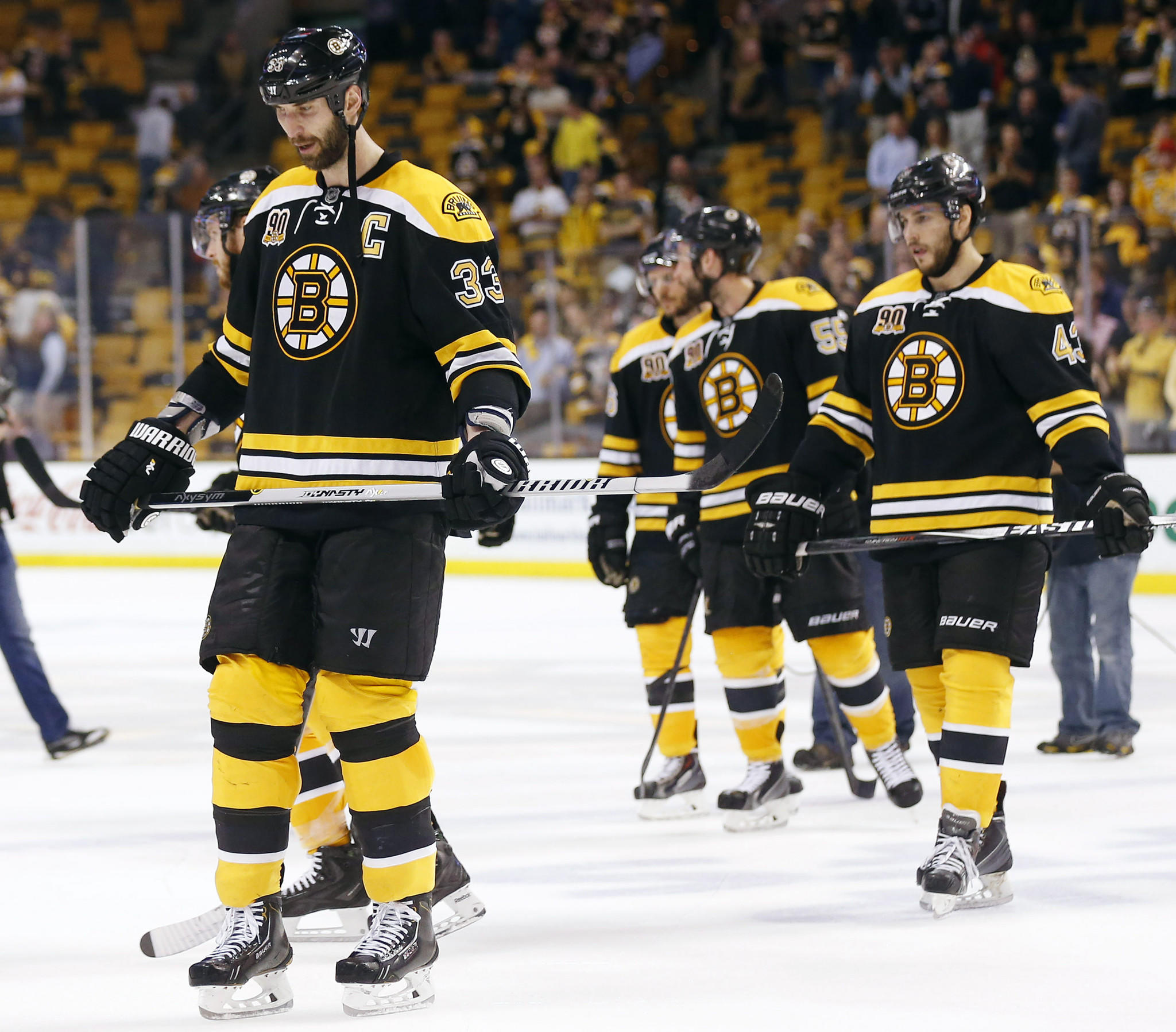 Boston Bruins defenseman Zdeno Chara (33) leads his team off the ice after their 3-1 loss to the Montreal Canadiens in game seven of the second round of the 2014 Stanley Cup Playoffs at TD Garden.