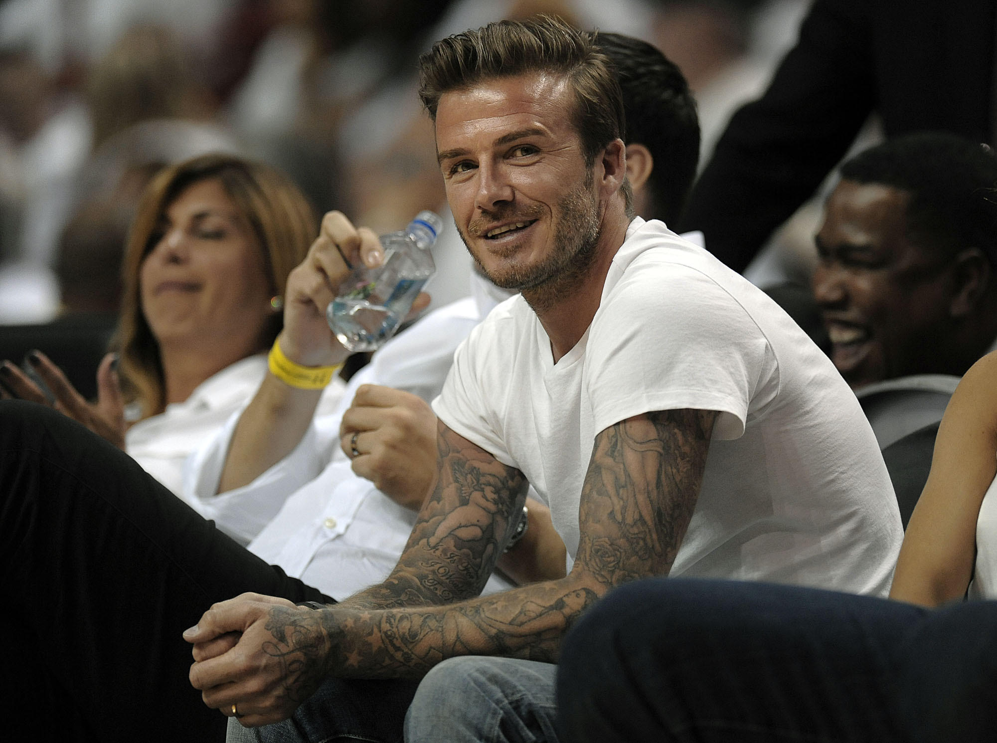 David Beckham watches a Miami Heat game at AmericanAirlines Arena.