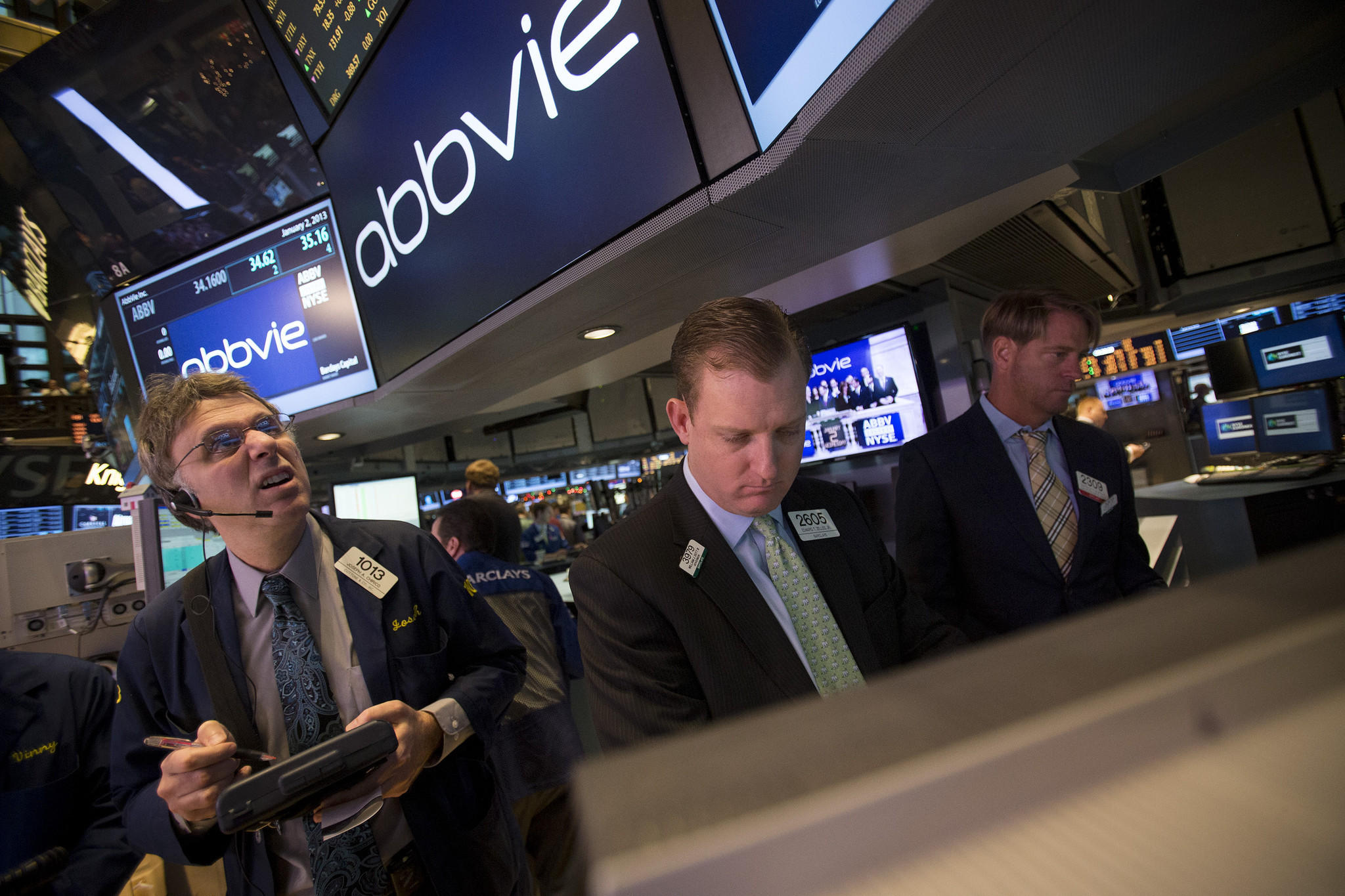 Traders work at the AbbVie Inc. booth on the floor of the New York Stock Exchange.