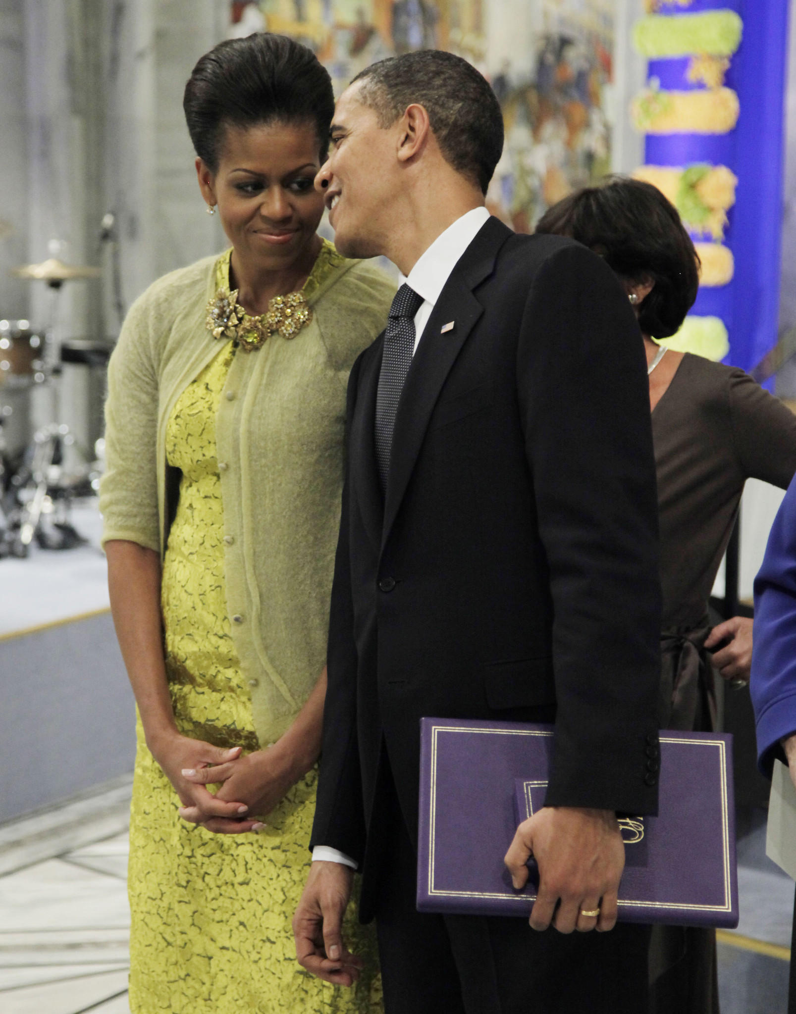 President and Nobel Peace Prize laureate Barack Obama speaks with his wife, first lady Michele Obama, after his Nobel lecture at the Nobel Peace Prize ceremony at City Hall in Oslo in 2009.