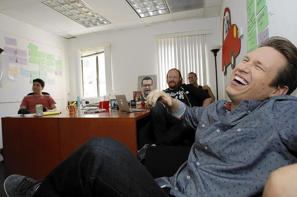 Pete Holmes (right) during a meeting in the writers room going over a monologue at his production offices at Warner Brothers Studios in Burbank, California.