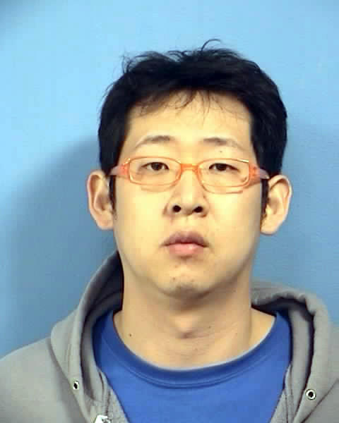 Edgar I. Kim, 29, (inset) is charged with one count of felony forgery, police said.