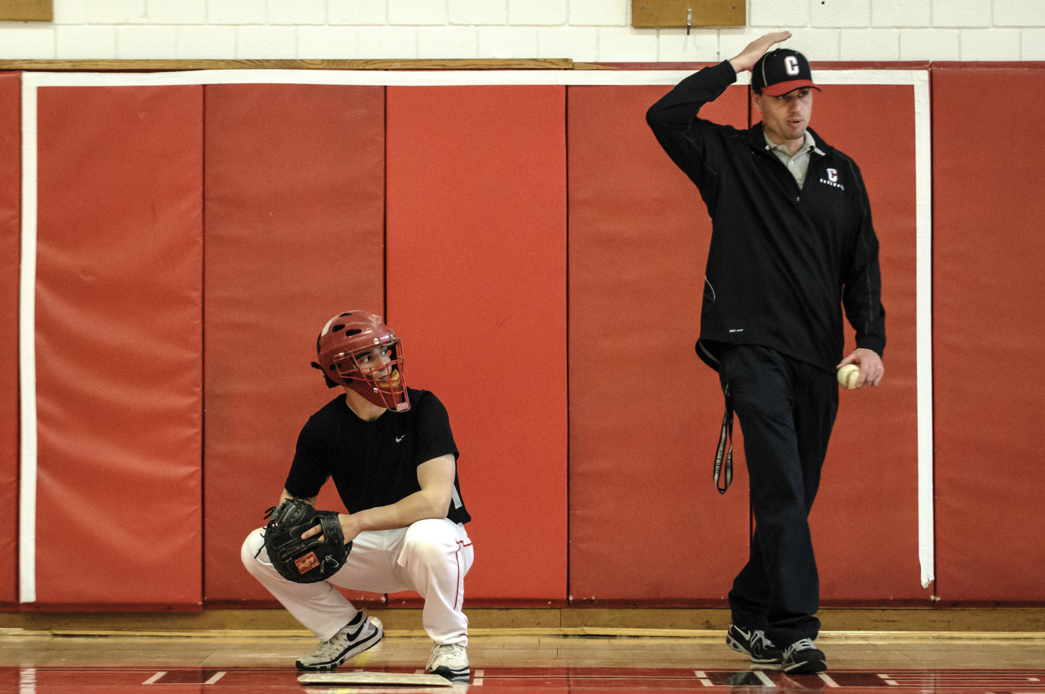 05.08.2014 - Cromwell, Ct - Cromwell catcher Kevin Radziewicz listens as coach Lewis Pappariella directs his players during practice. Photograph by Mark Mirko | mmirko@courant.com