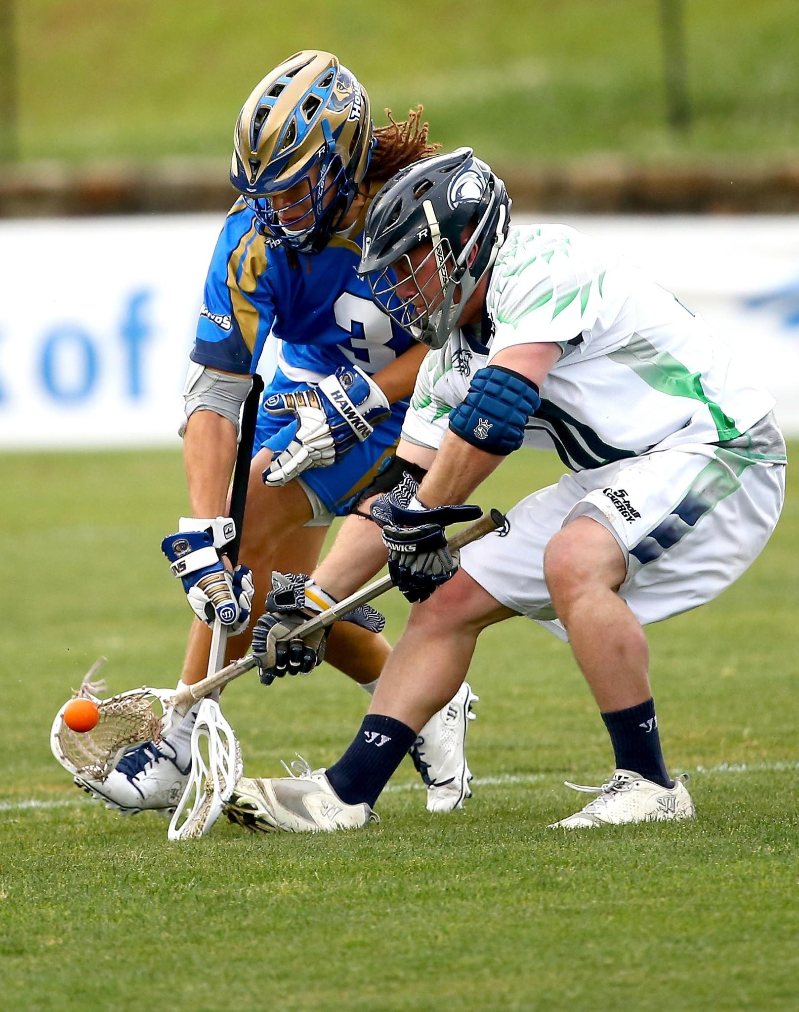 Former Loyola Maryland All-American Josh Hawkins, left, of the Charlotte Hounds battles for a loose ball with Adam Rand of the Chesapeake Bayhawks.