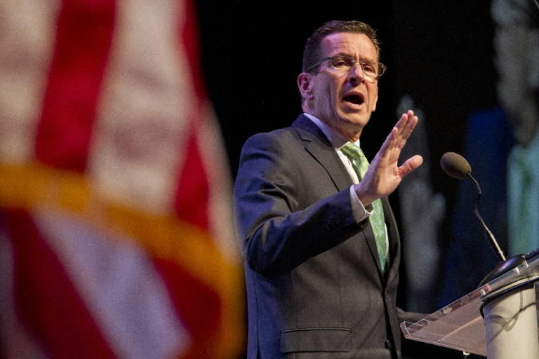 Gov. Dannel P. Malloy accepts the nomination to run for re-election, during the Democratic State Convention in Hartford Friday, May 16, 2014. Democrats gathered at the Connecticut Convention Center.