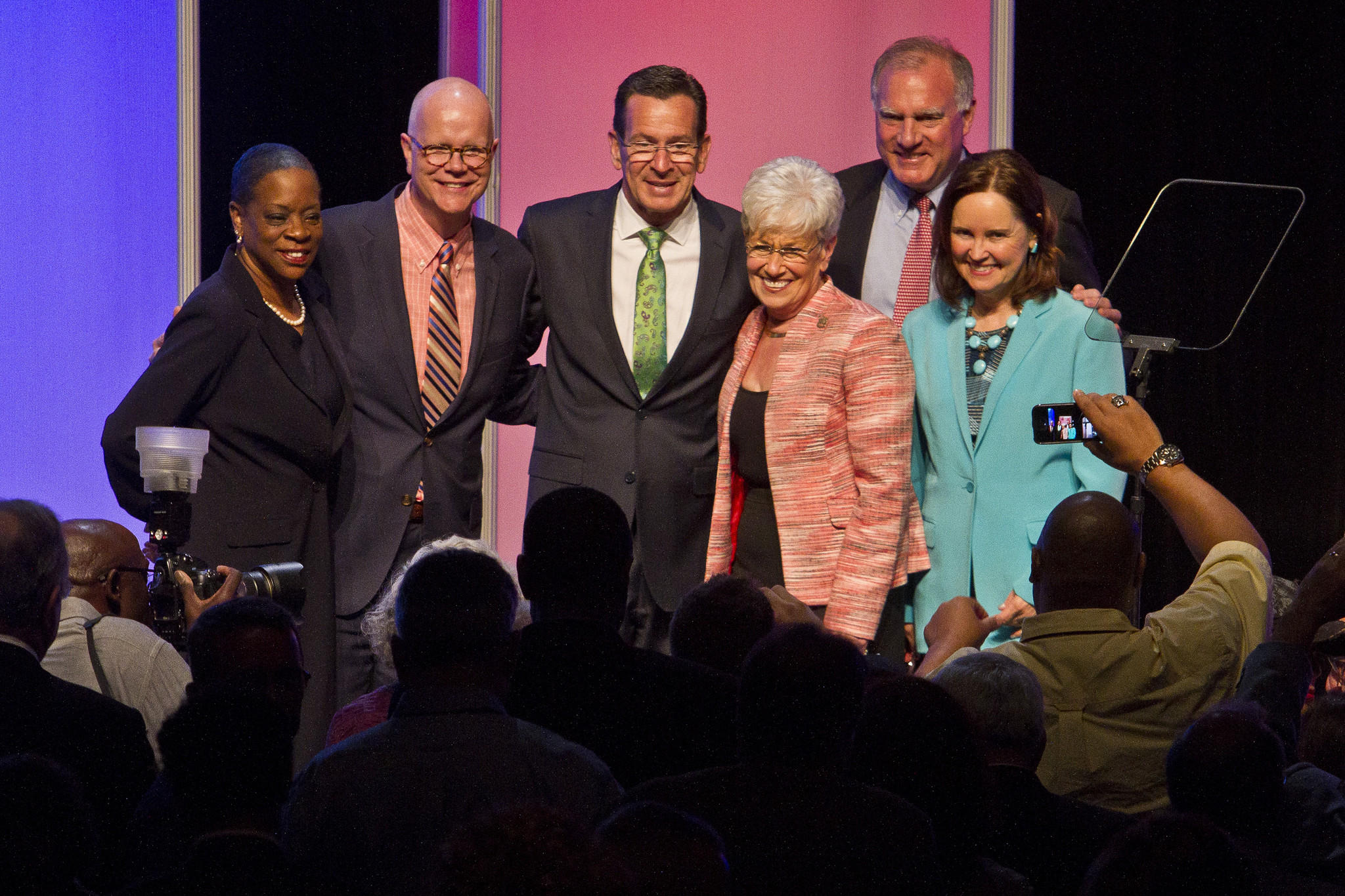 The Democratic nominees for election in November all gather at the stage for photos at the end of the Democratic Convention. From left, State Treasurer Denise Nappier, State Comptroller Kevin Lembo, Gov. Dan Malloy, Lt. Gov. Nancy Wyman, Attorney General George Jespen and Secretary of State Denise Merrill.