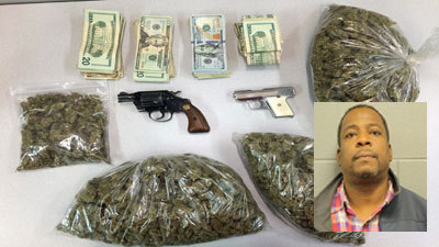 Drugs, guns, found at home with daycare center