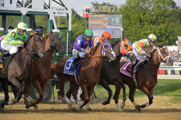 California Chrome, third from right, charges out of the starting gate in the 139th Preakne