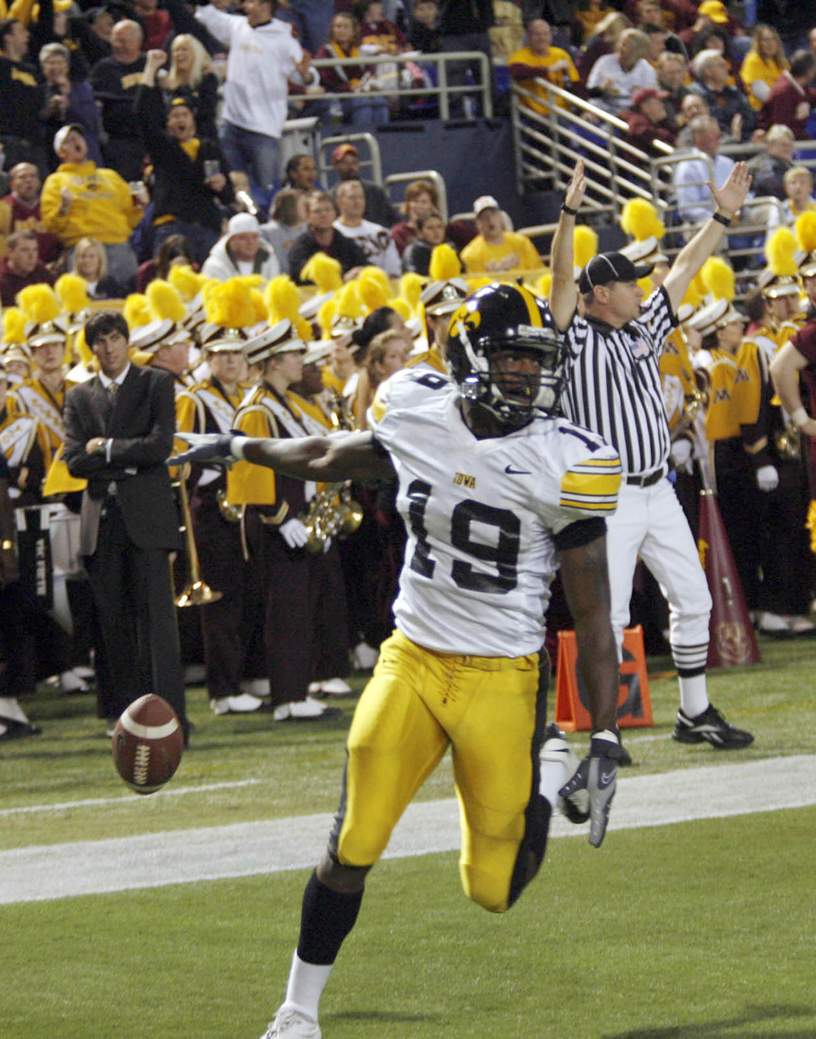 Iowa's Amari Spievey, a Middletown native, rolled into the end zone after intercepting a Minnesota pass and returning it 56-yards for a touchdown in Minneapolis on Nov. 22, 2008.