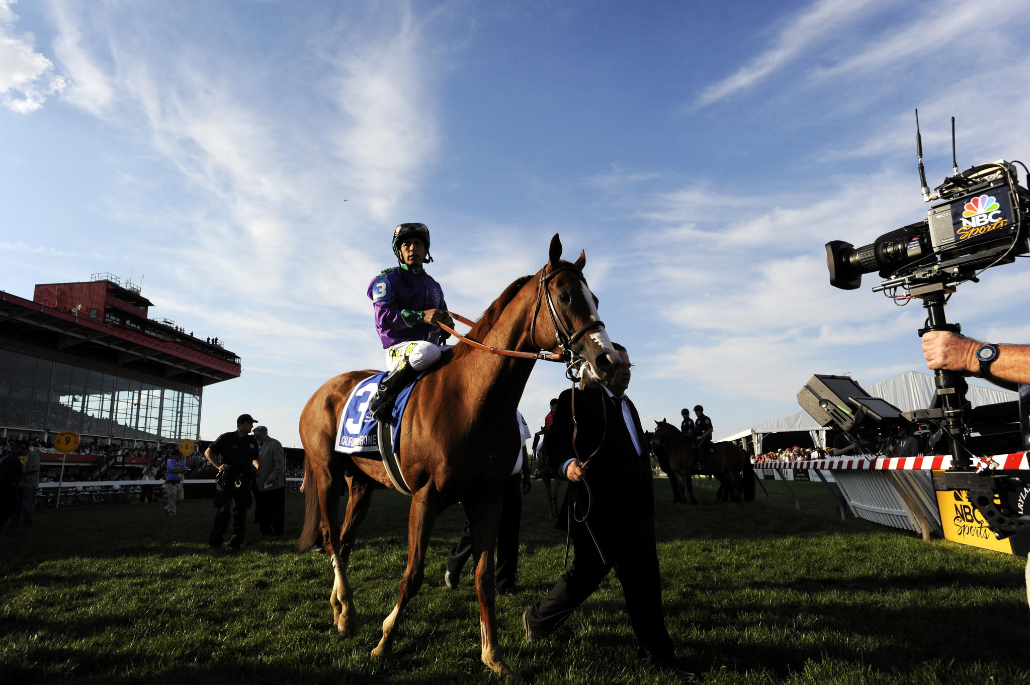 BALTIMORE, MD -- 5/17/14 -- The NBC Sports camera follows Jockey Victor Espinoza and California Chrome after they won the 139th Preakness Stakes at Pimlico Race Course.