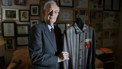 Norman Frajman is shown with the uniform he wore when he was liberated from Buchenwald concentration camp at the end of World War II. He will receive an honorary diploma from the Palm Beach County School District. Amy Beth Bennett, Sun Sentinel