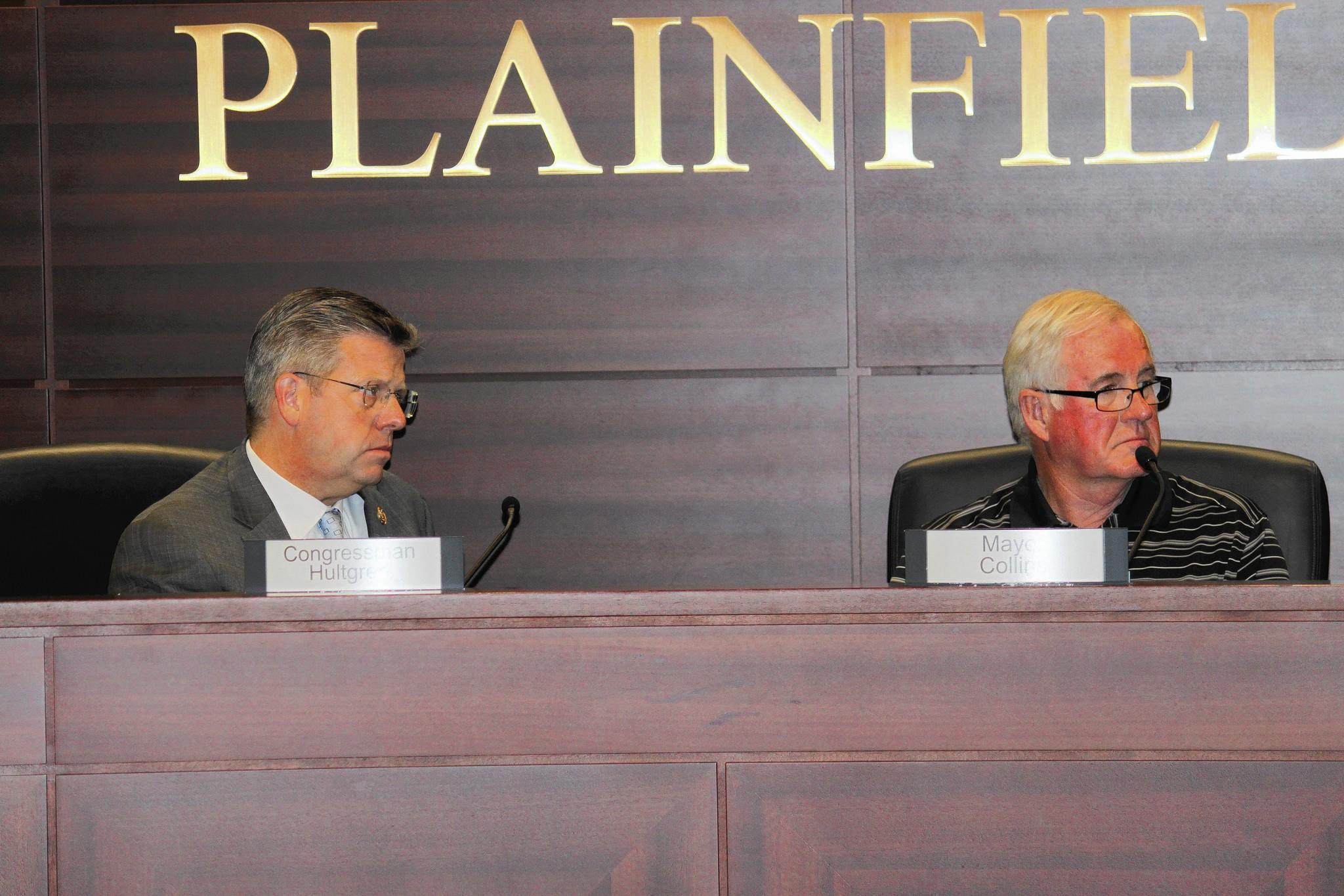 U.S. Rep. Randy Hultgren, left, met with Plainfield officials on May 16 to discuss train traffic through town.