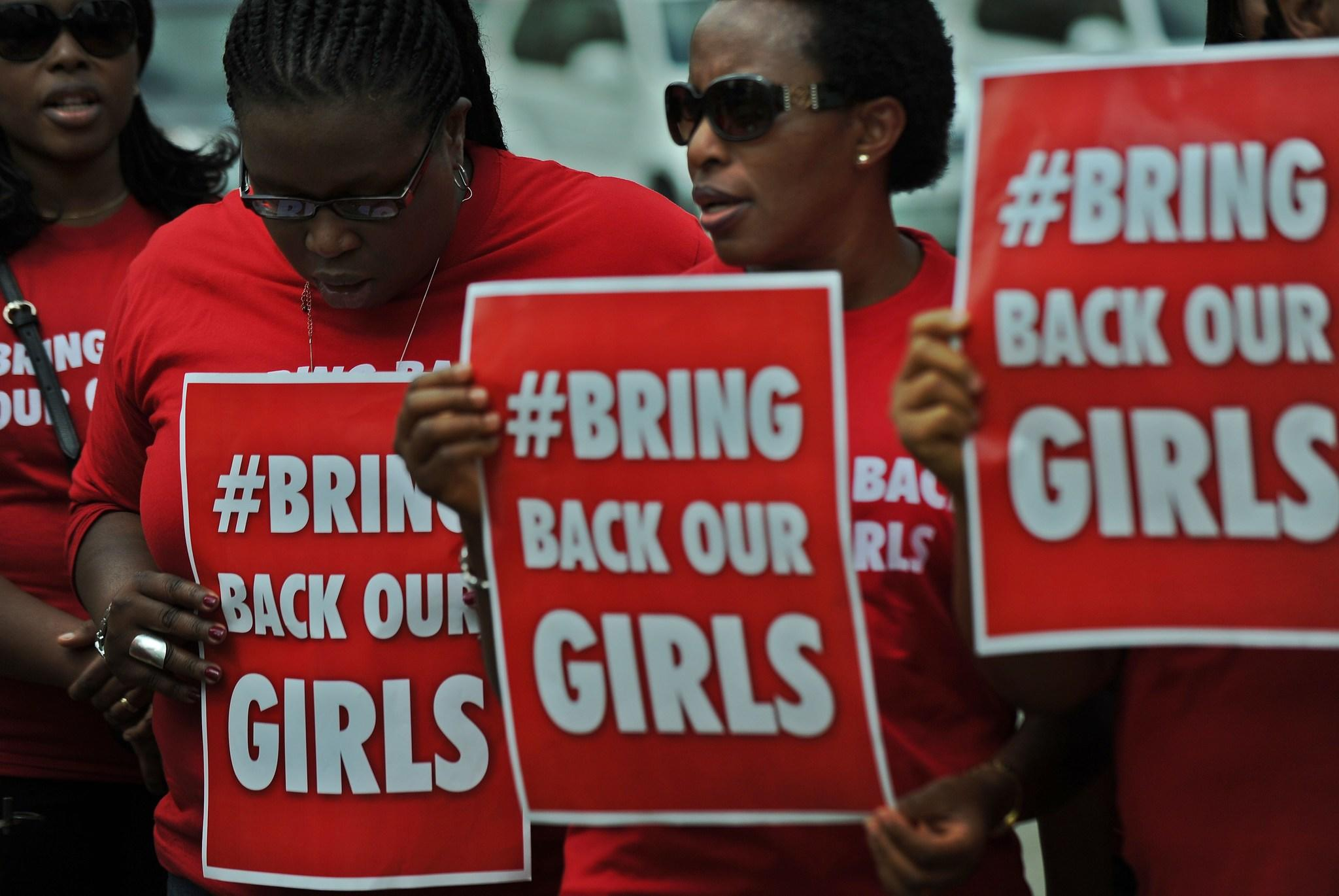 "Nigerian women living in Kenya demonstrate to press for the release of Nigerian school girls kidnapped in northern Nigeria. The ""#bringbackourgirls"" slogan has become a huge global phenomenon following the abductions."