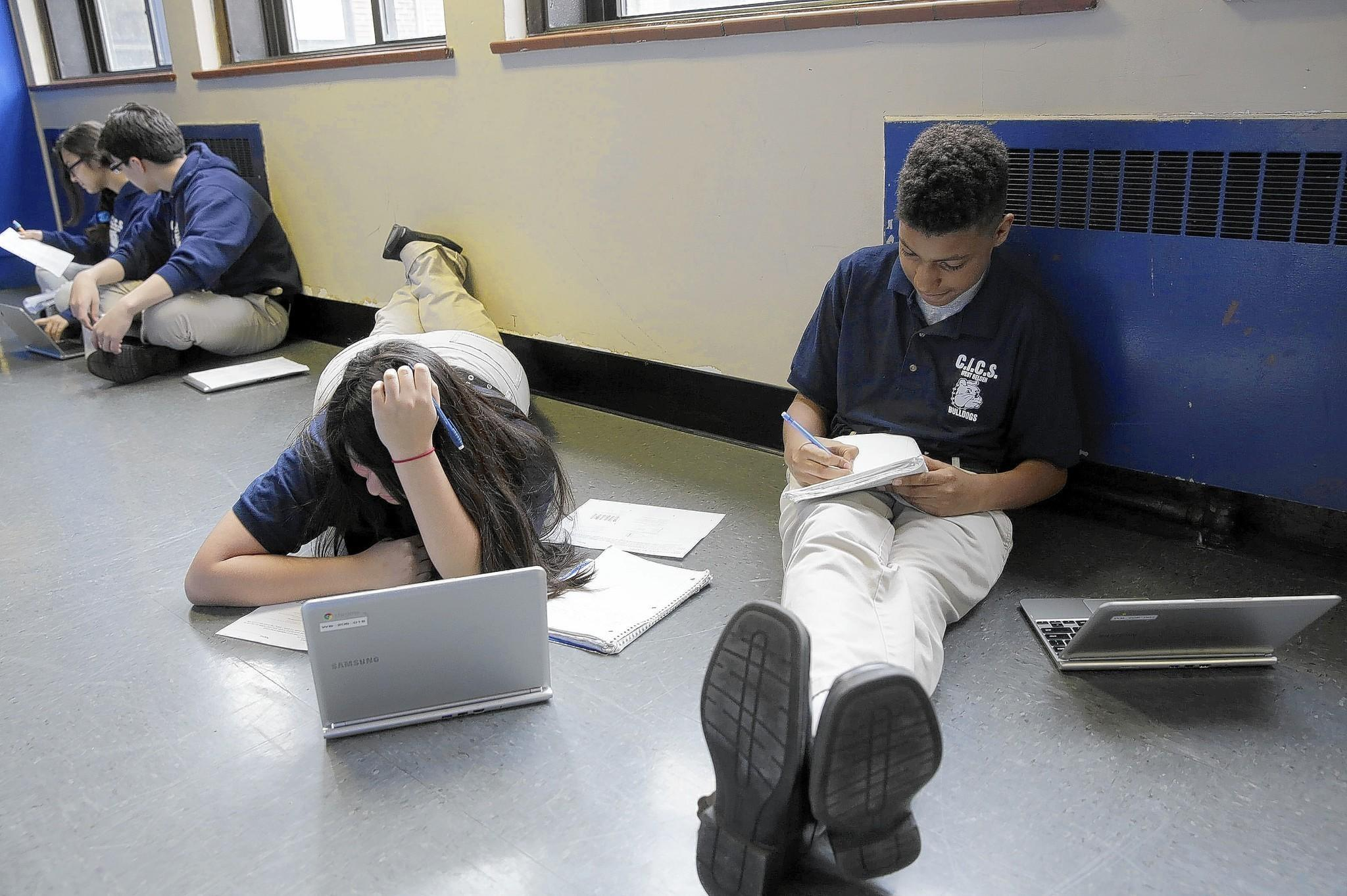 Lizbeth Mendez, 13, and Thomas Brooks, 12, study at CICS West Belden charter school. Common Core standards may aid student success.