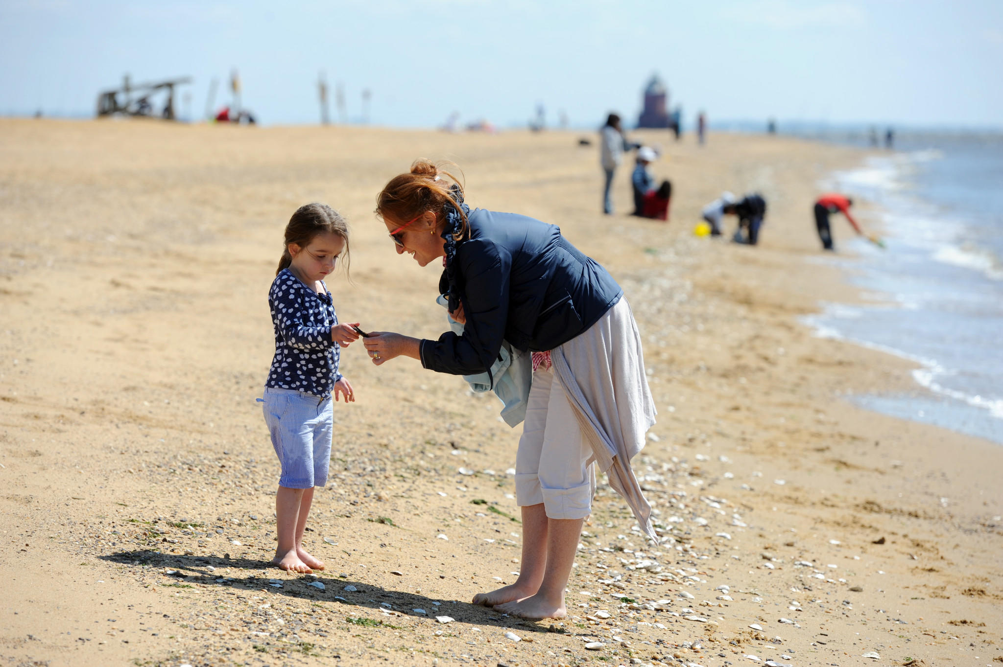 Sorcha Claassens, South Orange, NJ, and her daughter, Darcy Claassens, 3, look at things they find on the beach at Sandy Point State Park over Memorial Day weekend in 2013.