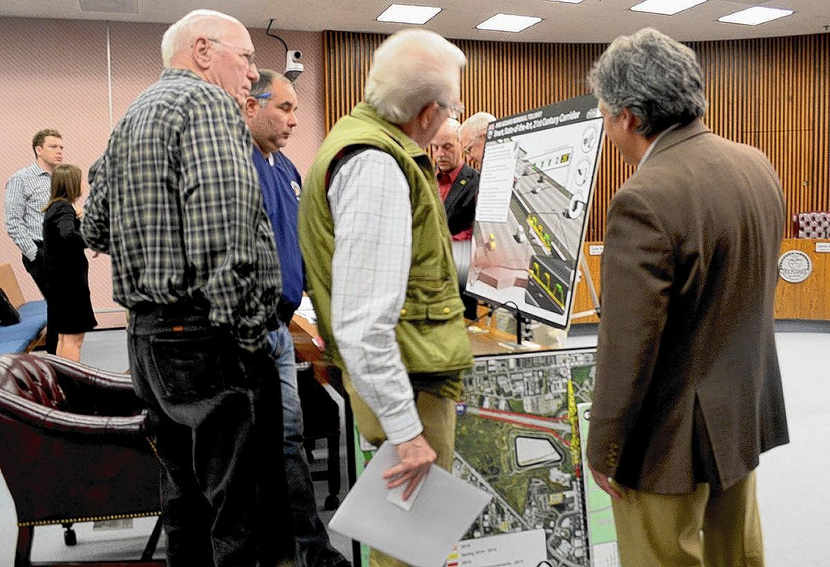 Illinois Tollway Deputy Chief of engineering for planning Rocco Zucchero, right, talks to Des Plaines residents about the I-90 Rebuilding and Widening Project at a town hall meeting.