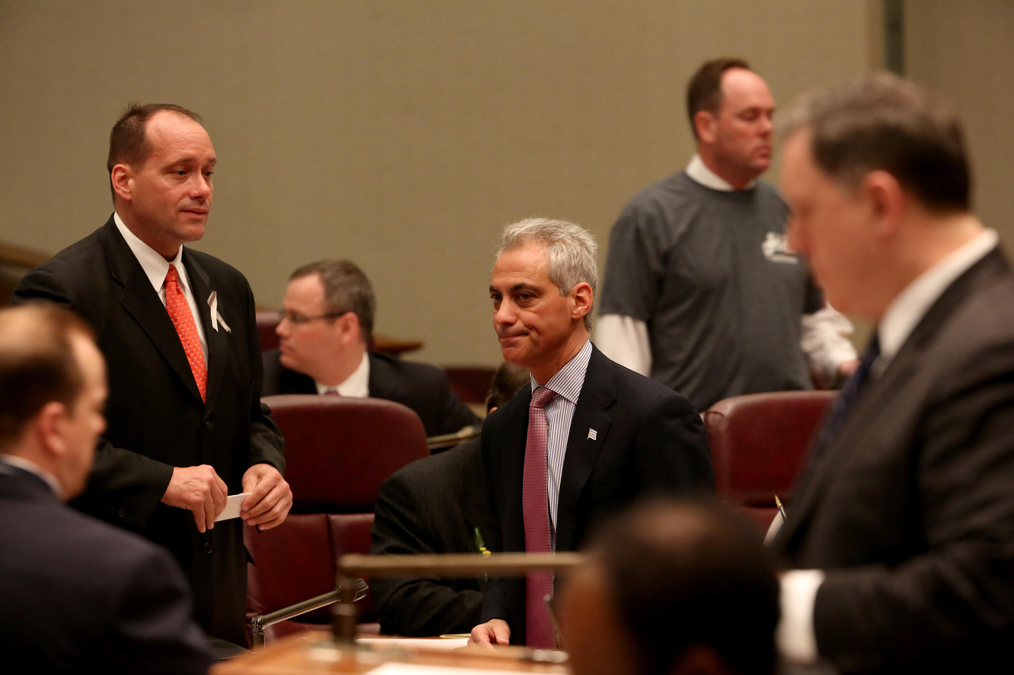 Mayor Emanuel works the City Council floor before the start of an April meeting.