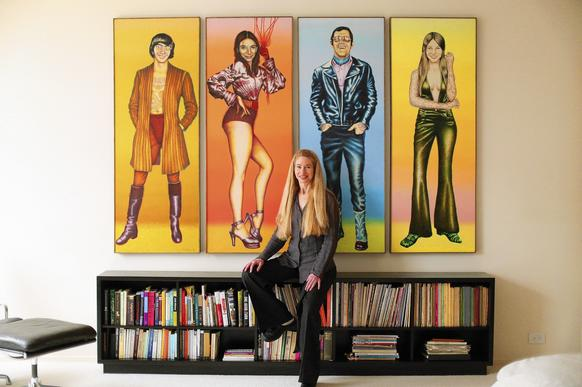 Leslie Buchbinder, a former Chicago PR arts maven and arts patron, stands for a portrait with paintings of, from left, her brother Brad, mother Gilda, father Hank, and herself, at age 14, painted by Ed Paschke in 1971 and 1972.