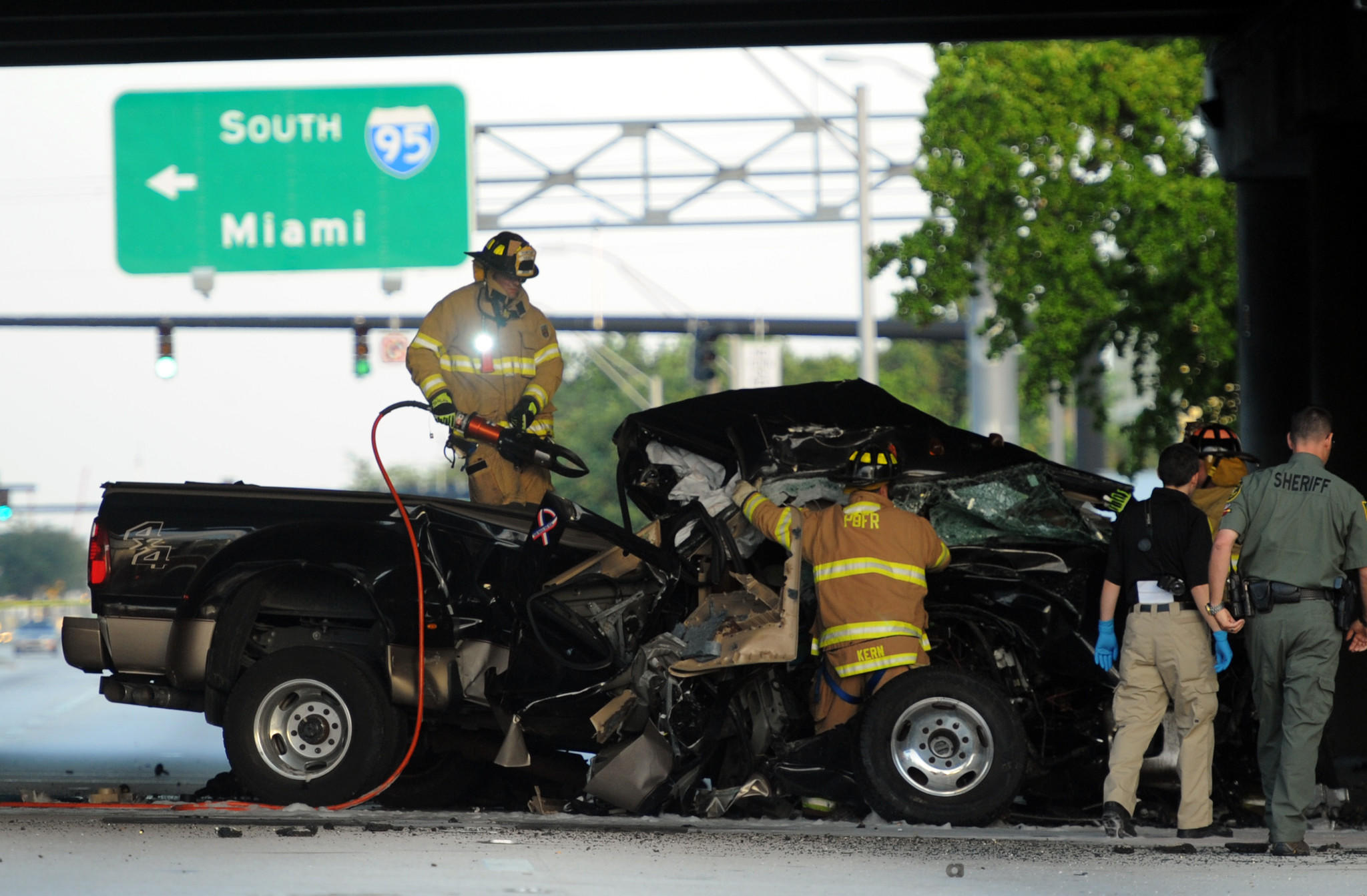 Pompano Beach Fire and Rescue cut away the roof of a pickup truck to remove the trapped vicitim of a one vehicle fatal accident on westbound Atlantic Blvd., in Pompano Beach